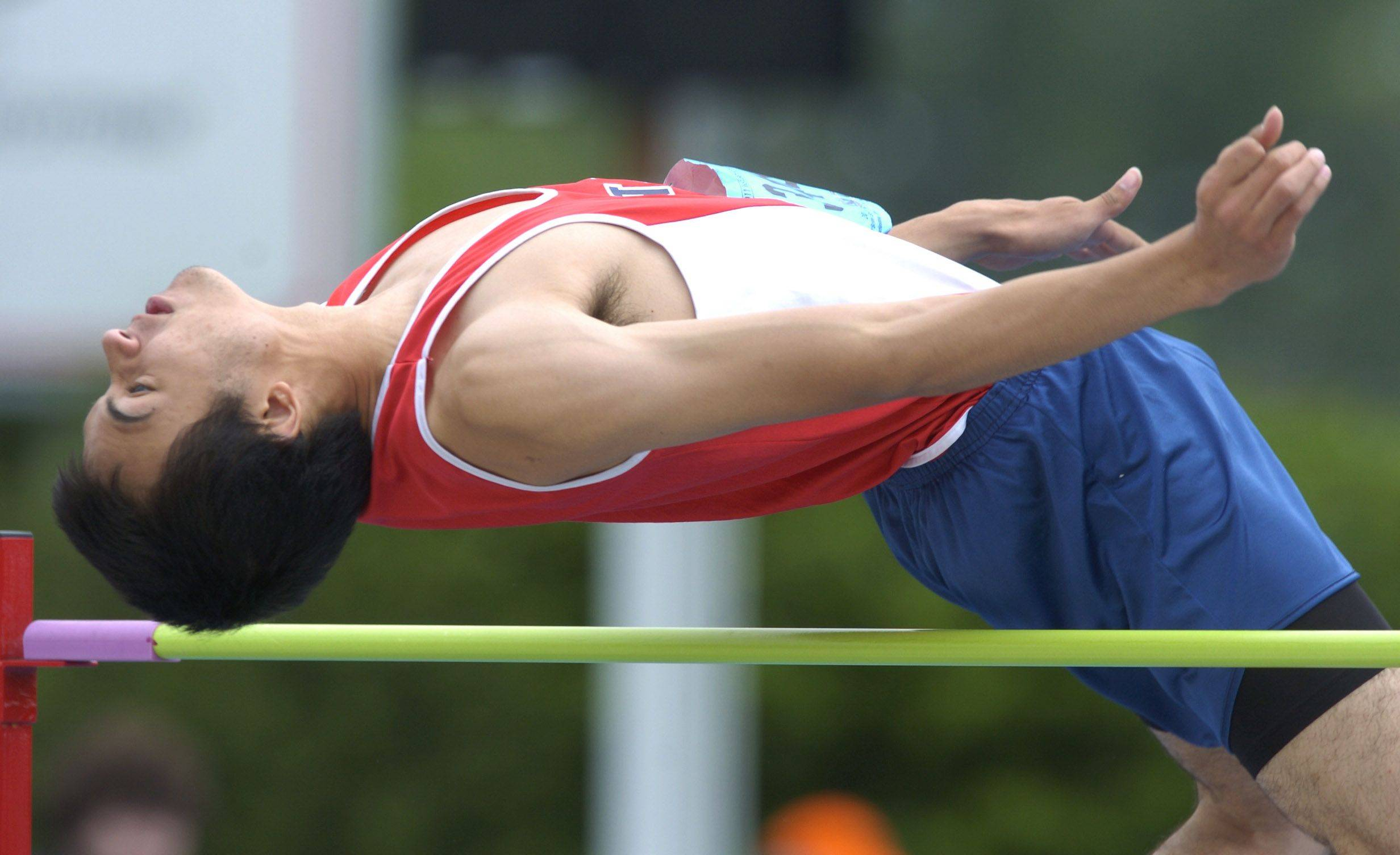 Conant's Ben Bowers clears the bar in the class 3A high jump during the boys state track finals in Charleston Saturday.