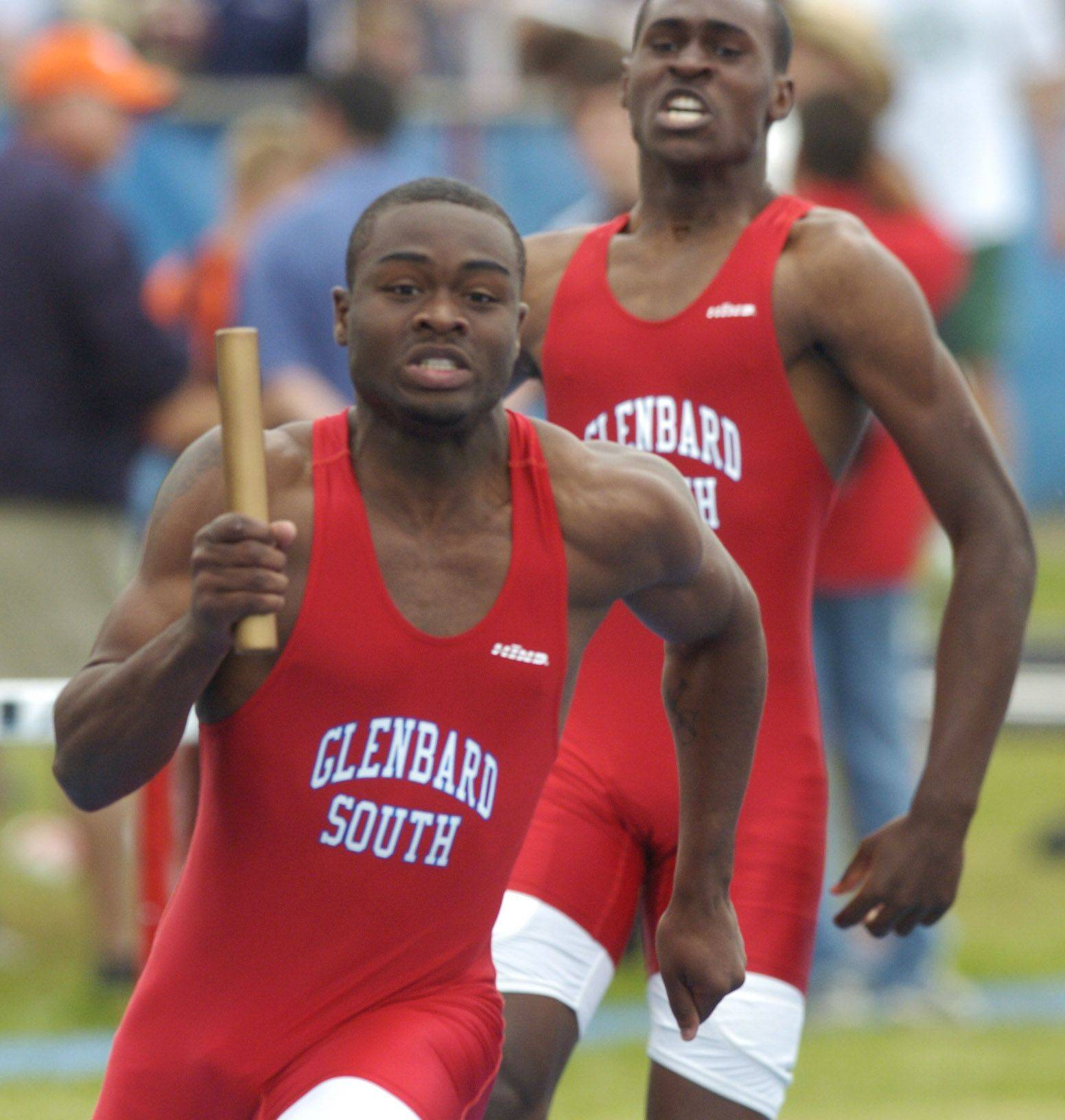 Glenbard South's Wesley Sanders runs after taking the baton from teammate Lamar Johnson in the 400-meter relay during the boys state track finals in Charleston Saturday.