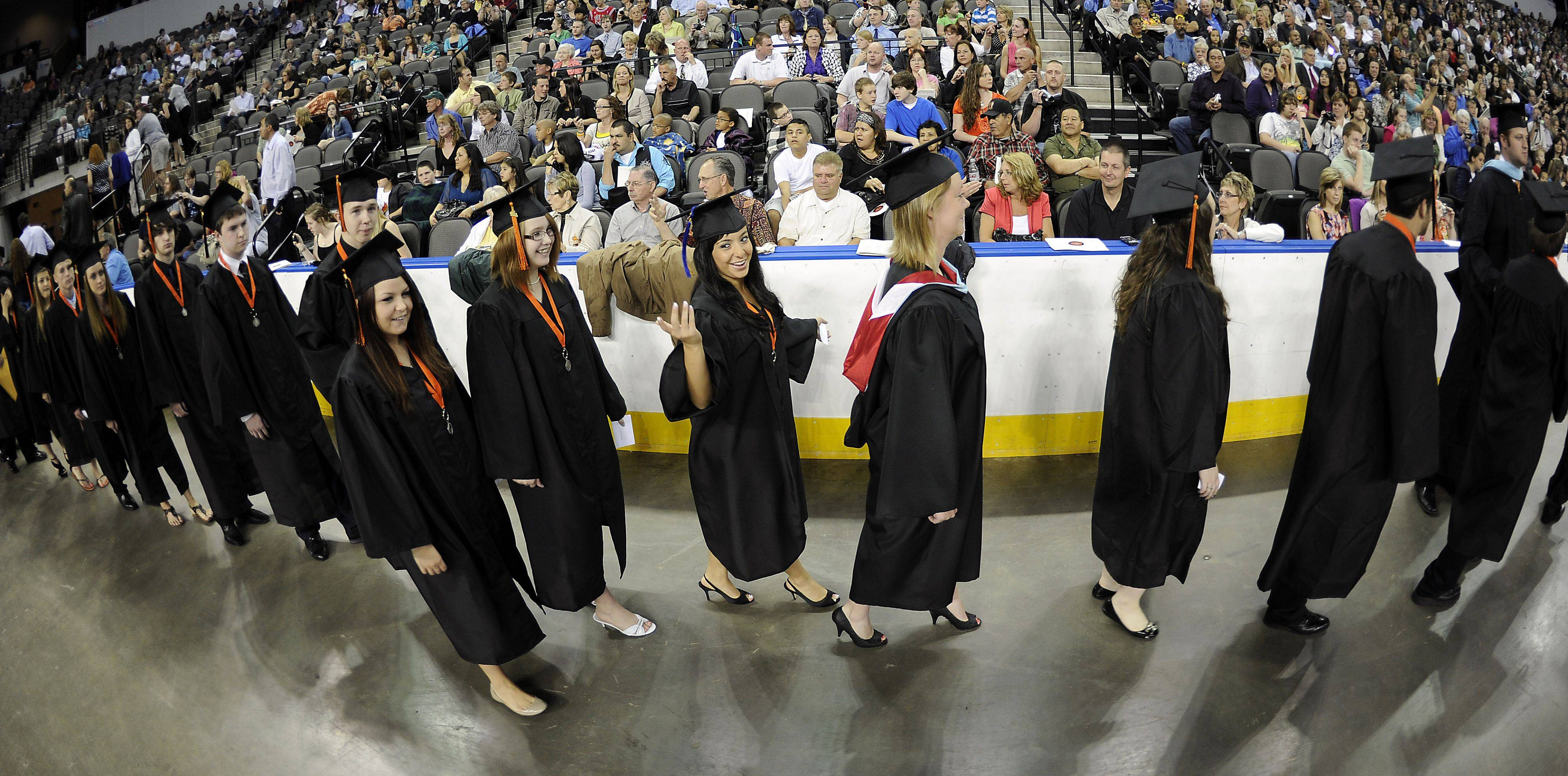 St. Charles East's commencement class of 2011 file past hundreds of proud parents and friends before they became official graduates at the Sears Centre on Sunday.