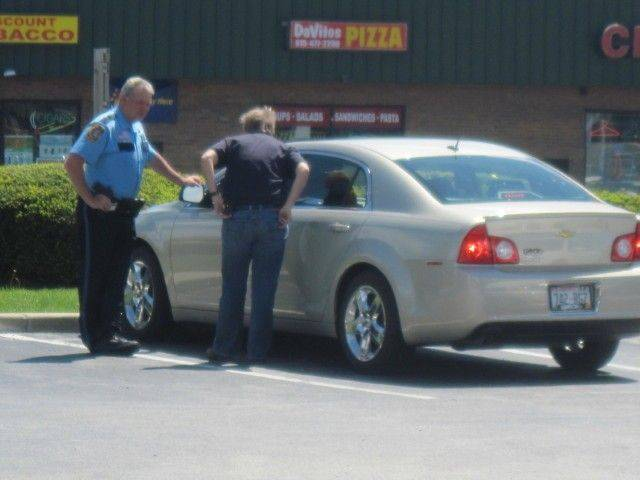 McHenry County sheriff's Sgt. Karen Groves and Deputy Matt Matusek talk to a motorist he stopped for surfing Facebook.