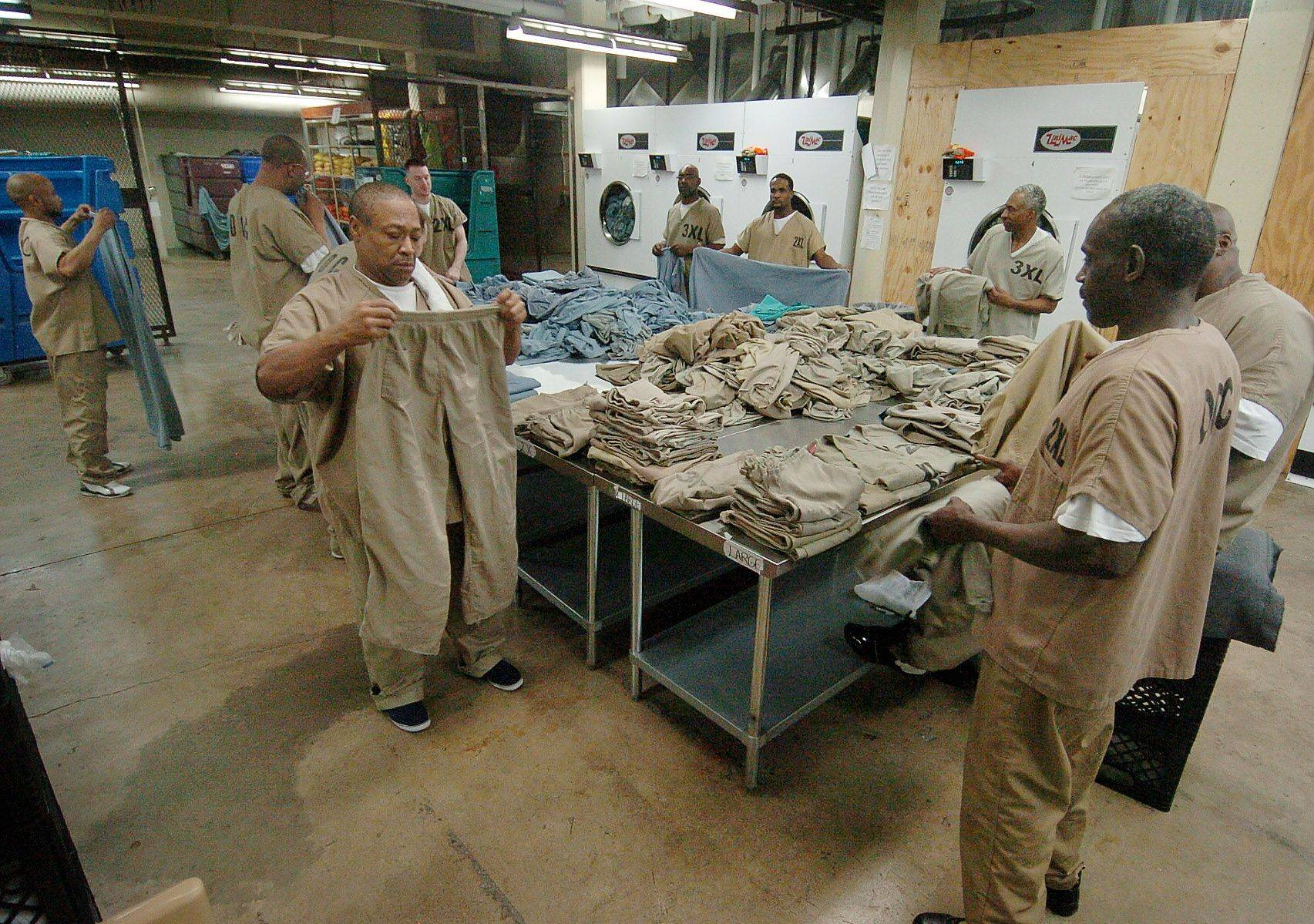 Low- to medium-risk military veterans work in the laundry room in the basement of Cook County Jail.