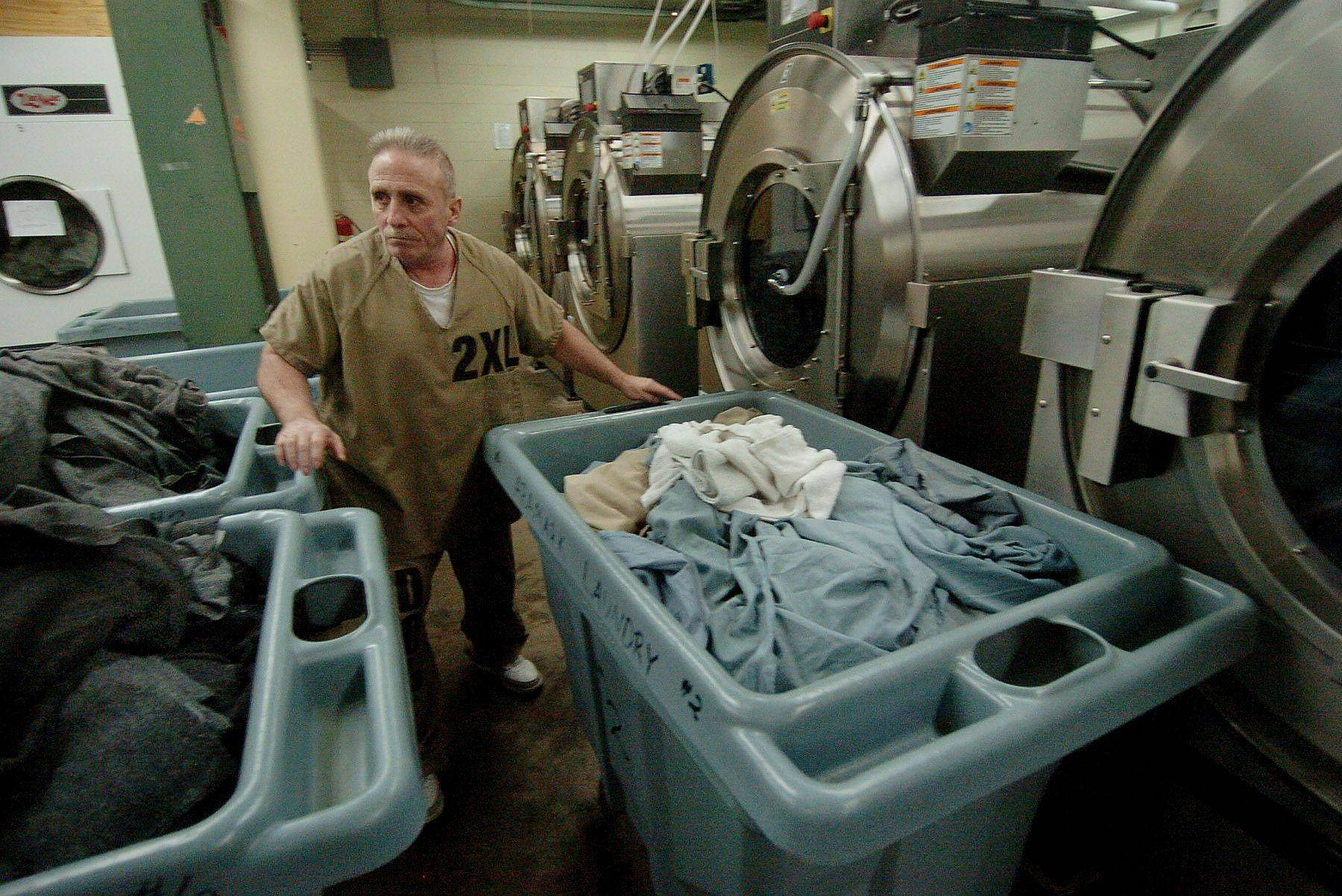 U.S. Marines veteran Carmen Verlotta of Chicago moves bins of laundry in the prison laundry room in the basement of Cook County Jail as part of a special program for veterans charged with felonies.