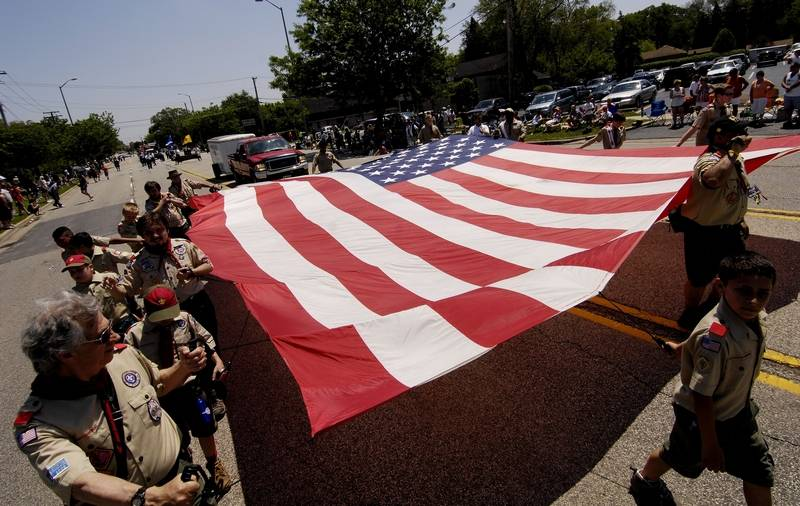 Members of Boy Scout Troop 65 carry a large American flag during the 2011 Wood Dale Memorial Day Parade.