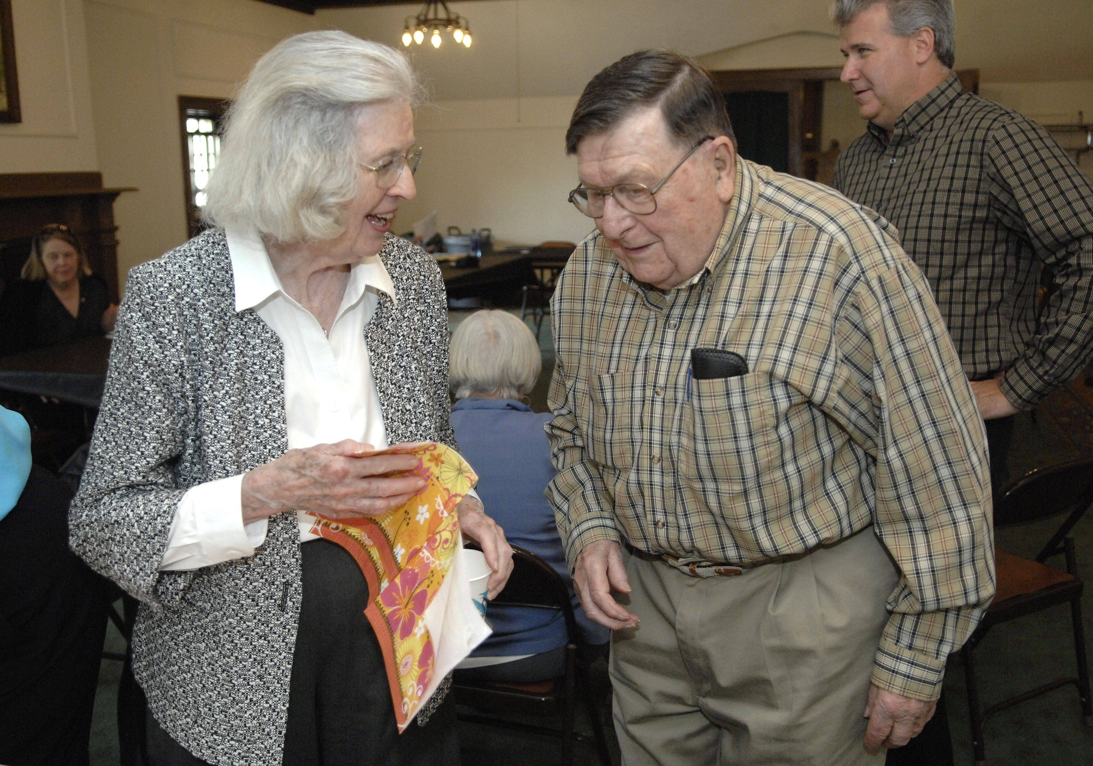 Barbara Anderson and Melvin Peterson chat while waiting in line for cake and ice cream at the Baker Community Center annual board of directors meeting May 19. Anderson has been on the board for 55 years and Peterson for 68 years.