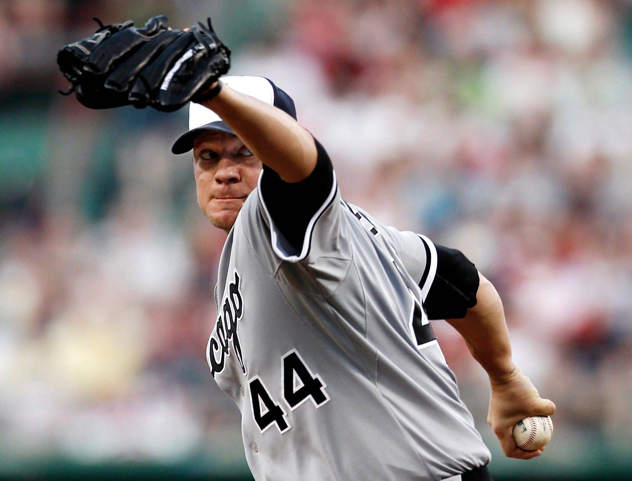 White Sox starting pitcher Jake Peavy delivers against Red Sox on Monday.