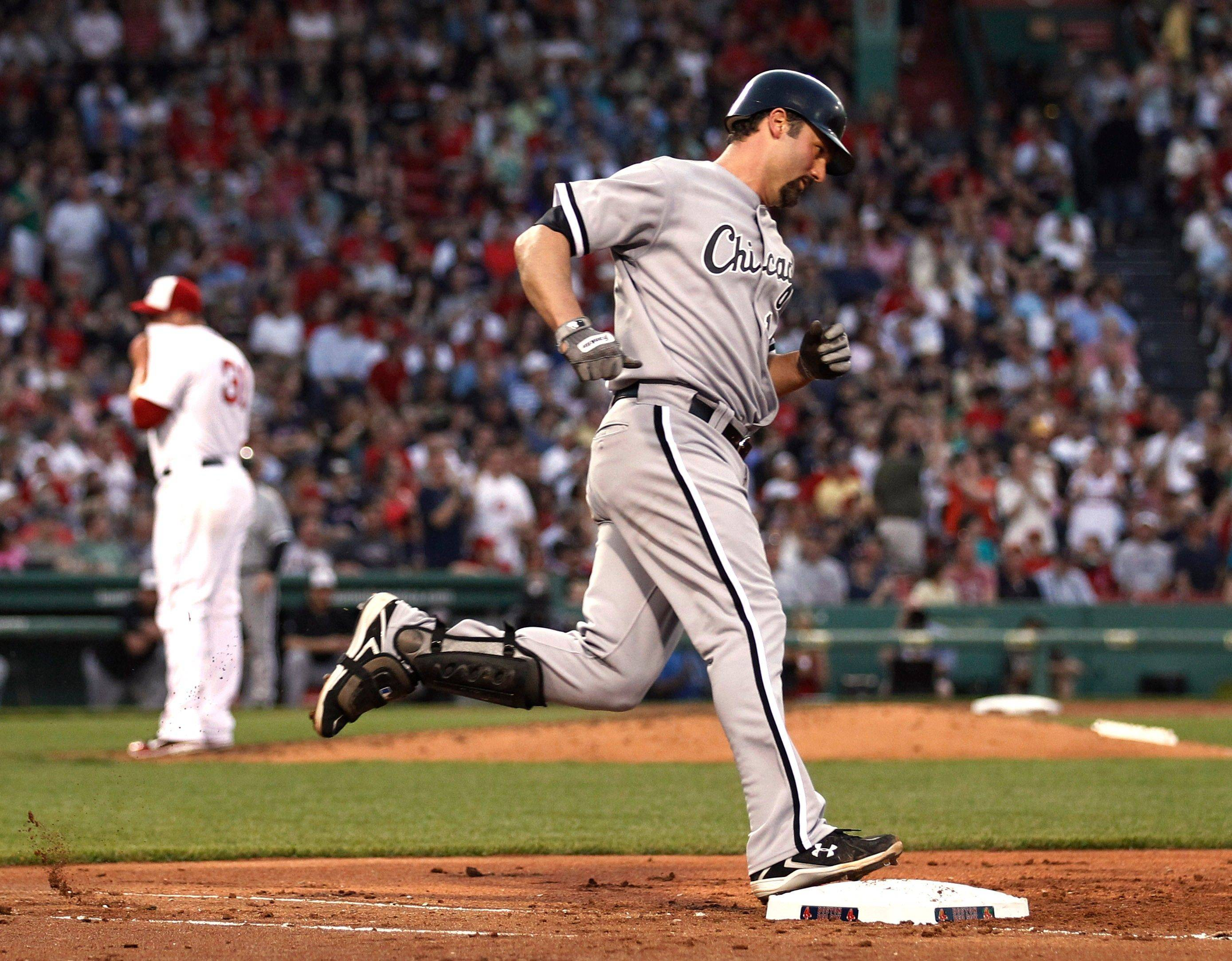 The White Sox' Paul Konerko rounds the bases after his home run in the third inning Monday.