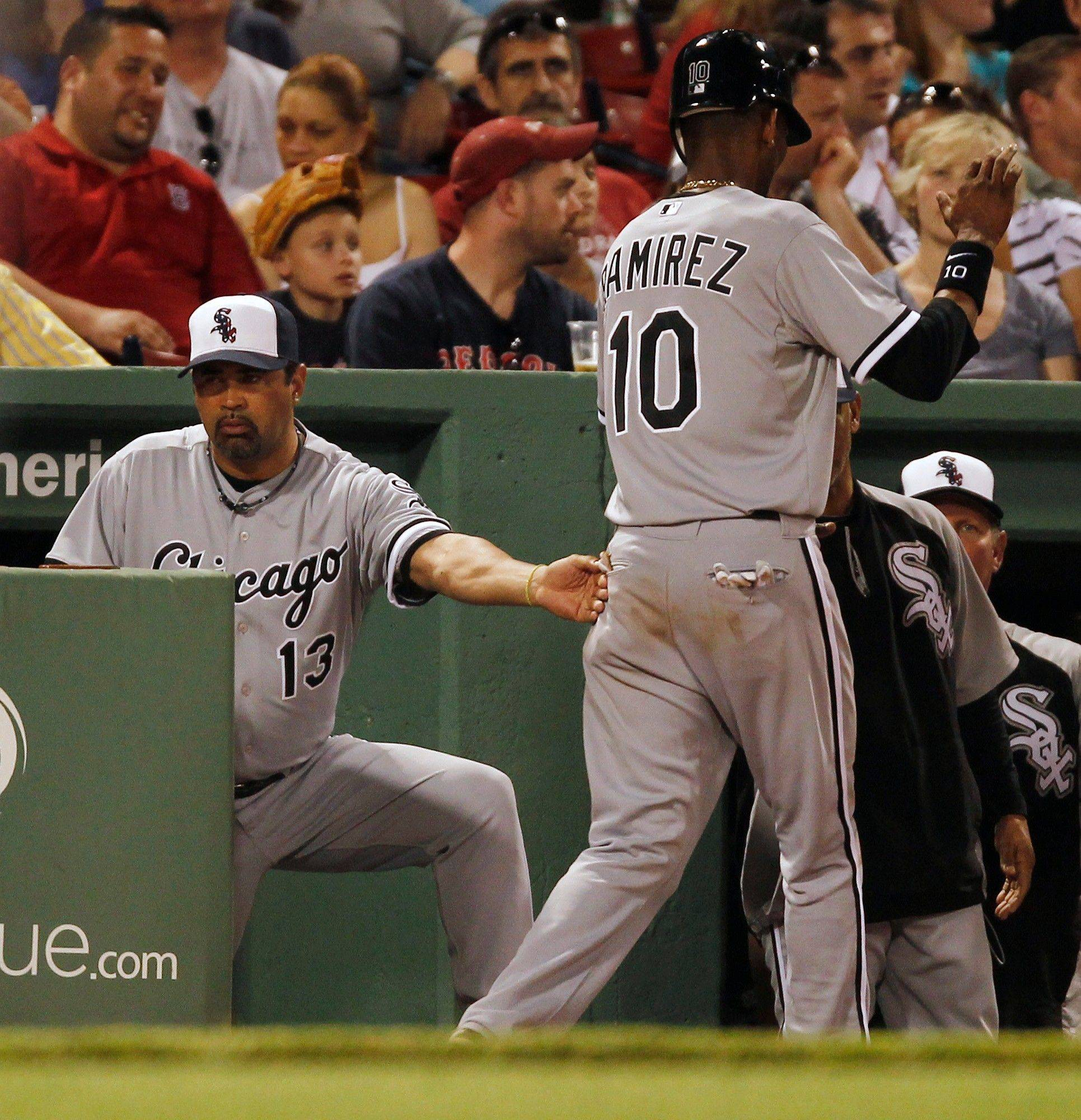 The White Sox' Alexei Ramirez gets a pat on the back from manager Ozzie Guillen after scoring on a 2-run single by Carlos Quentin in the sixth inning Monday.