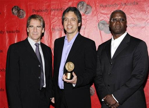 'Men of A Certain Age' cast members, Scott Bakula, left, Ray Ramano, center, and Andre Braugher pose together at the 70th Annual Peabody Awards.