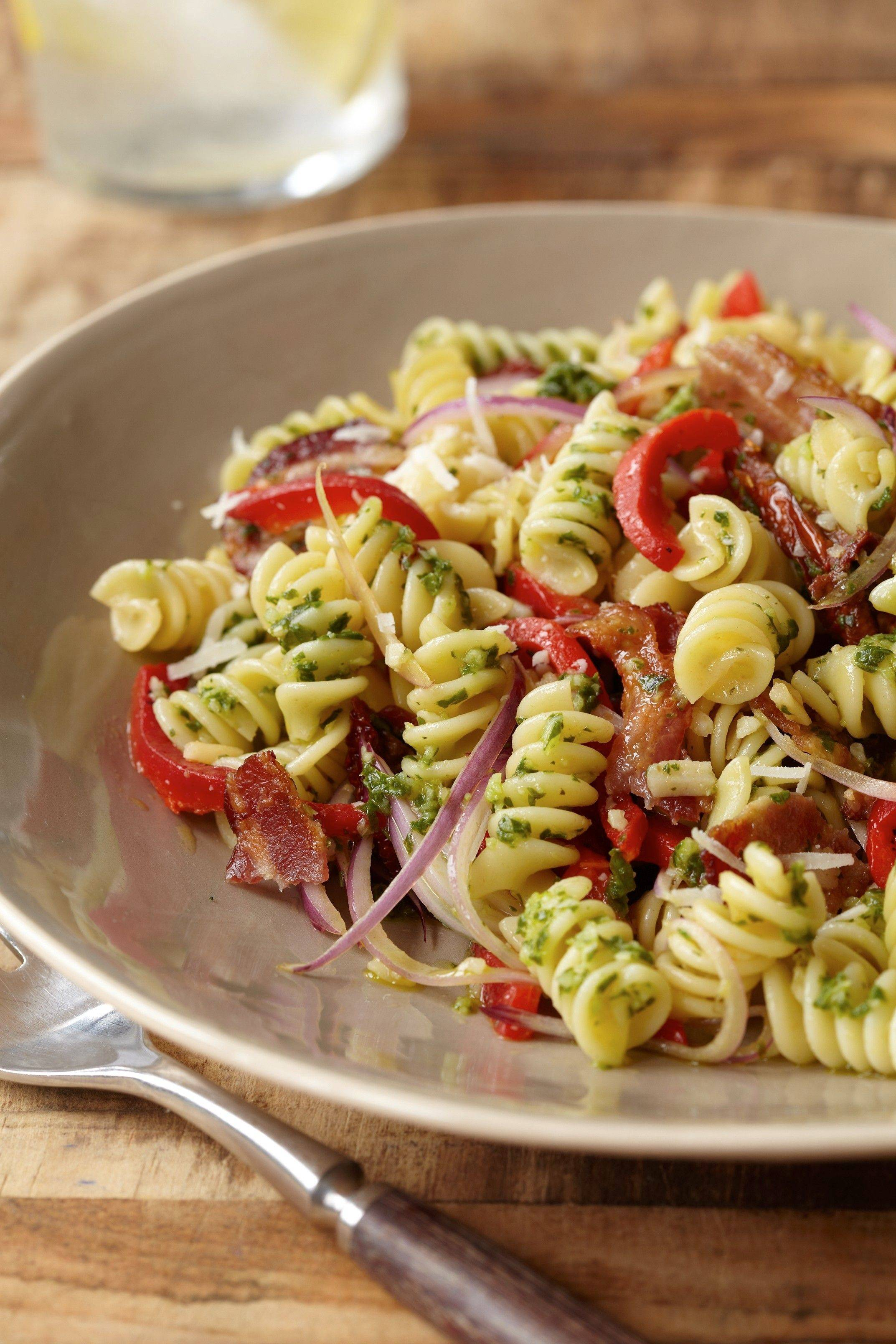 "You'll be proud to serve this tasty bacon and pesto pasta salad from Aaron McCargo Jr.'s ""Simply Done, Well Done"" at your next barbecue or potluck picnic."