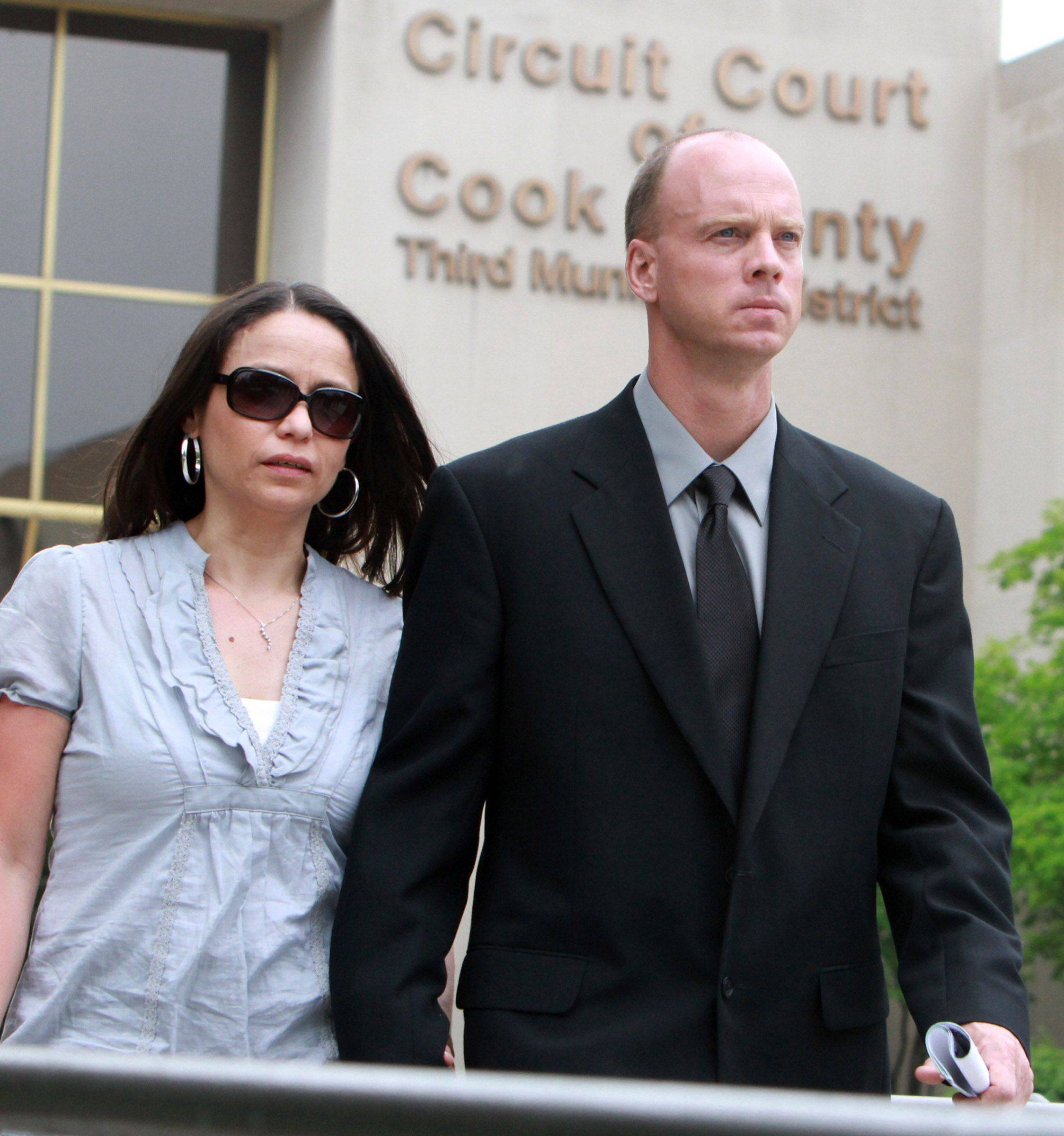Former Streamwood police officer James Mandarino and his wife, Sophie Mandarino, leave the Cook County courthouse in Rolling Meadows after his sentencing hearing Tuesday.