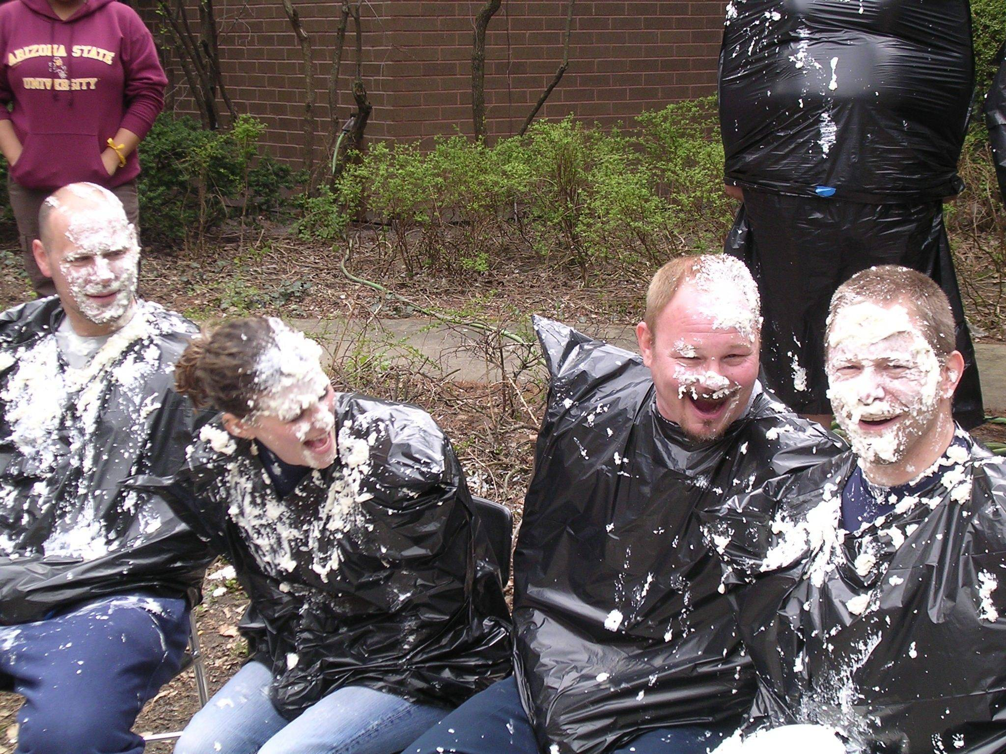 From left, Dean Carlson, Julie Deka, Jay Benz and Rob Hartwig smile through the whipped cream.