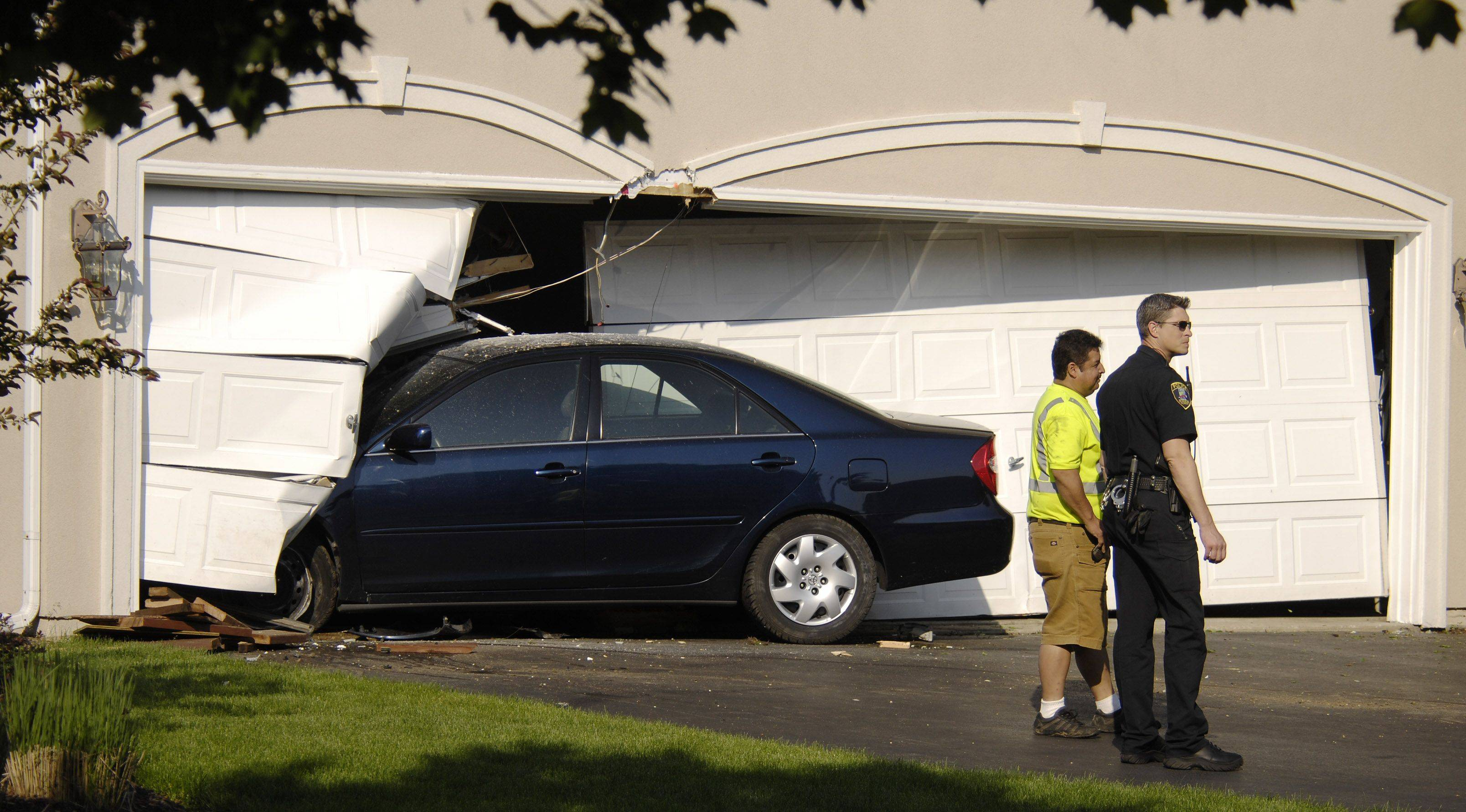 A car crashed into a home at the intersection of Fox Chase Blvd and Huntington Road in St. Charles about 7:15 a.m. Tuesday morning.