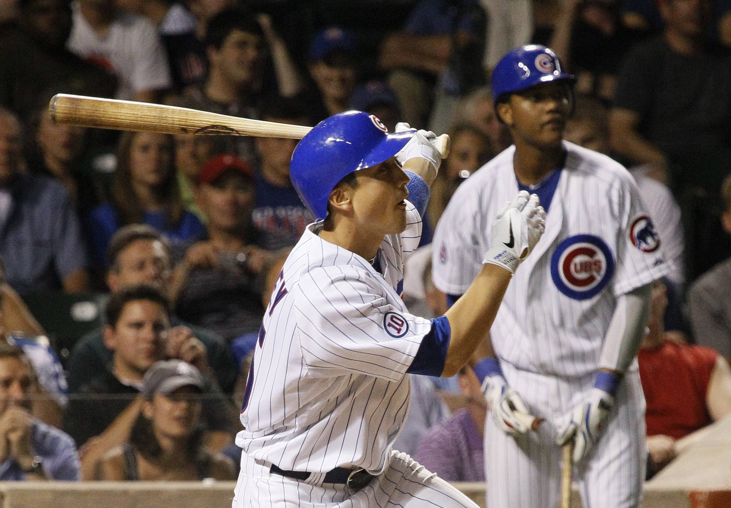 Darwin Barney follows through on an RBI double as Starlin Castro watches from the on deck circle during the eighth inning at Wrigley Field.
