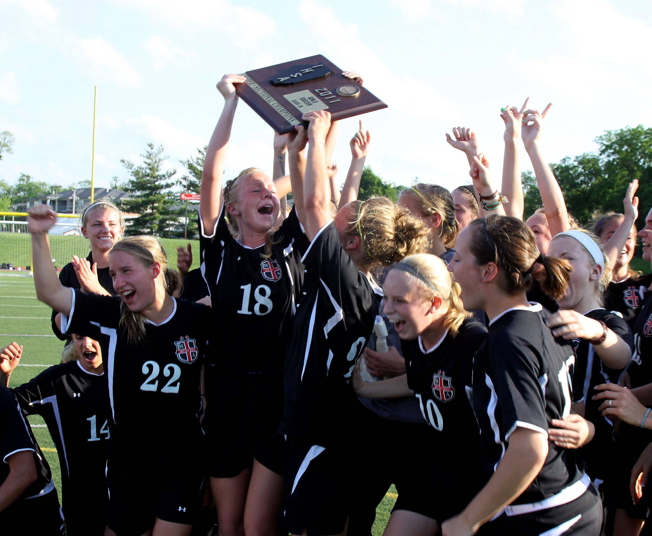 Wheaton Academy celebrates their win over St. Francis in the Class 2A Benedictine supersectional girls soccer match Tuesday in Lisle.