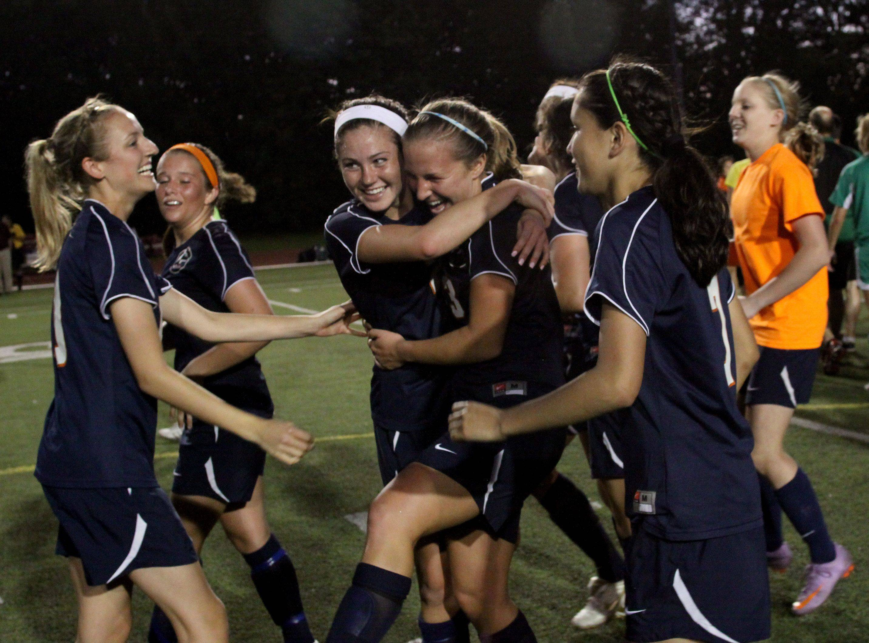 Naperville North celebrate their win over York in the Class 3A Benedictine supersectional girls soccer match Tuesday in Lisle.