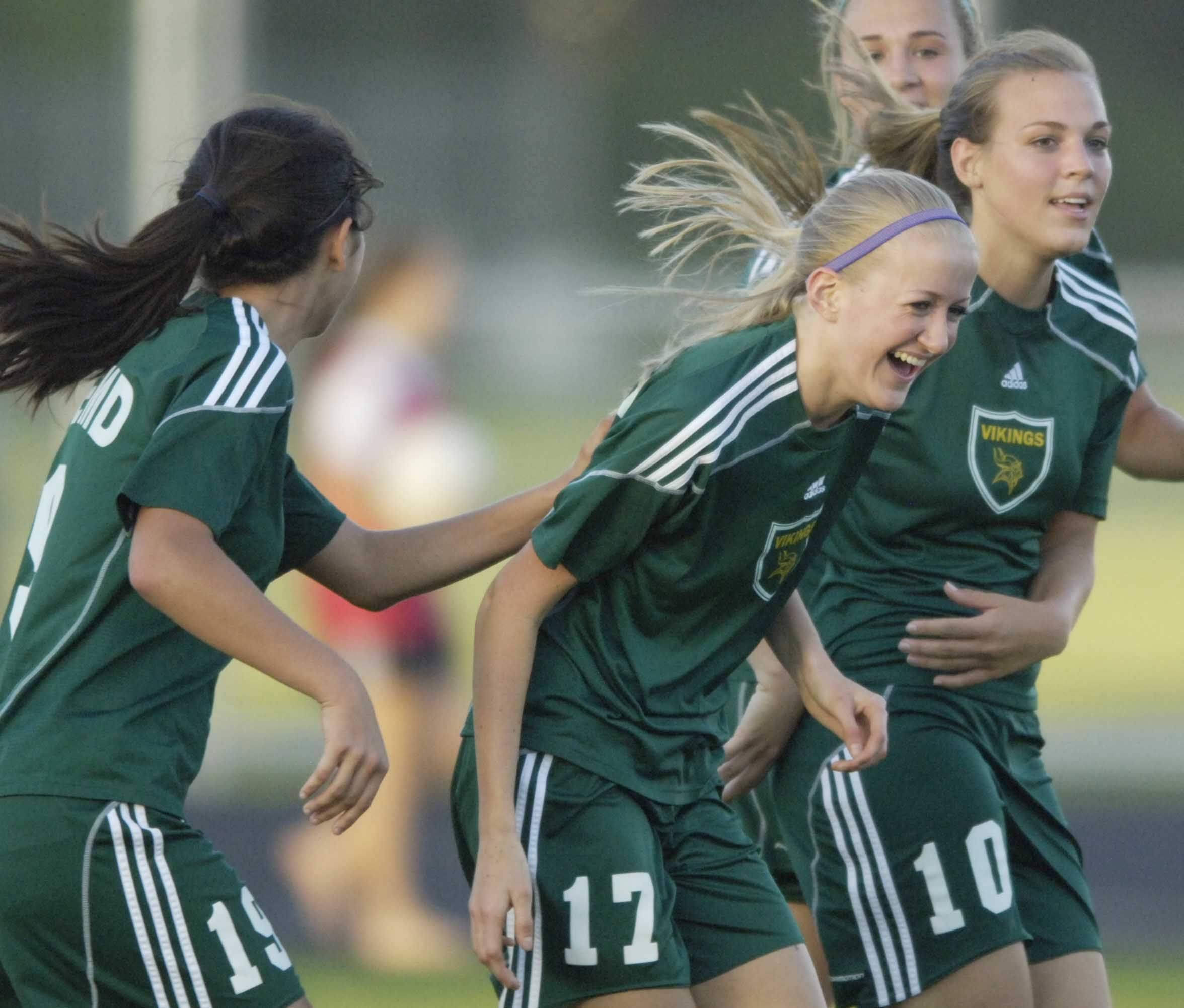 Fremd?s Kira Heggeland, middle, celebrates her goal with teammates Rebecca Freeman, left, and Elise Kotsakis during the Barrington Class 3A girls soccer supersectional Tuesday.