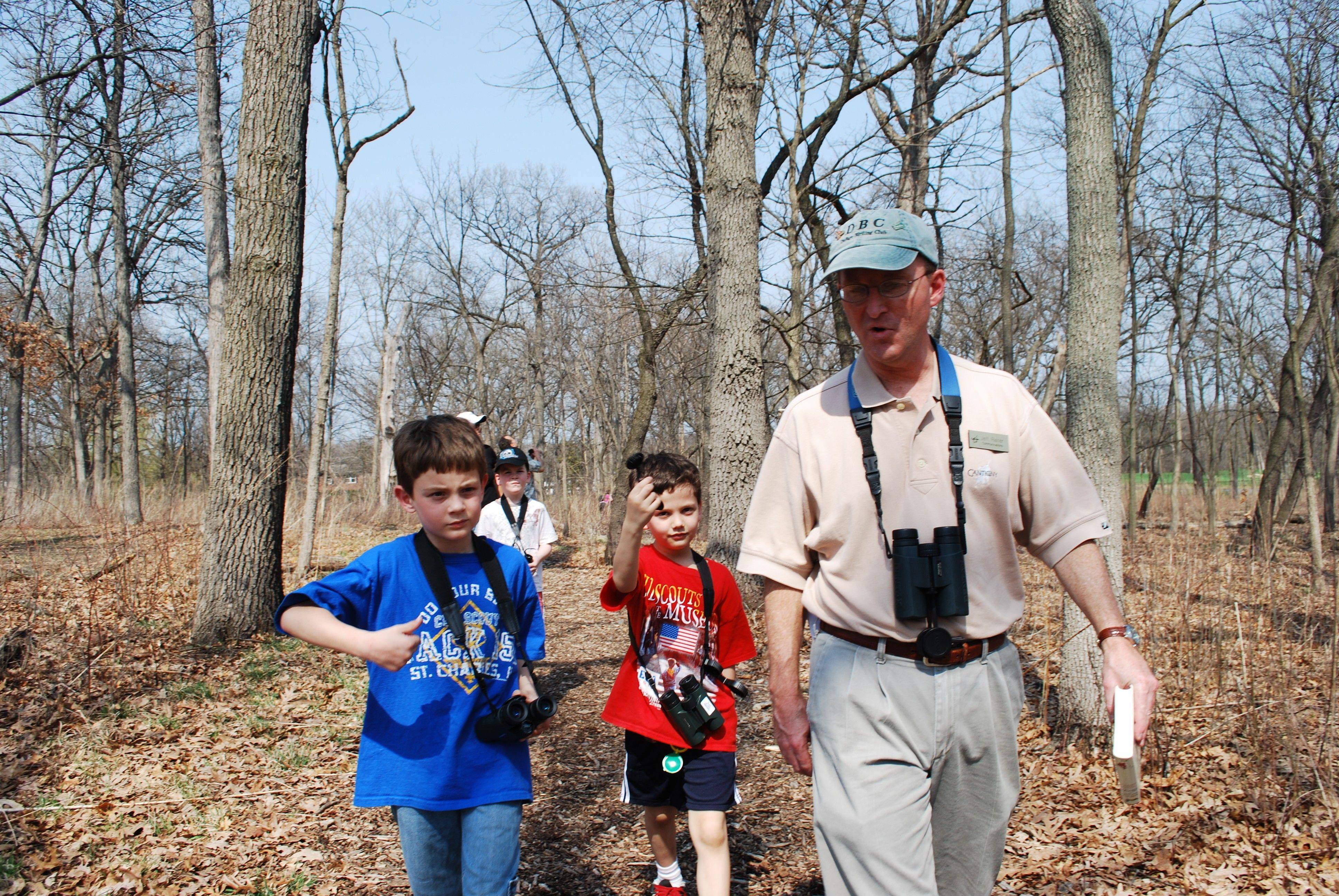 Cub Scouts Erik Andersen and Nathan Beardsley stroll with Jeff Reiter at Cantigny.