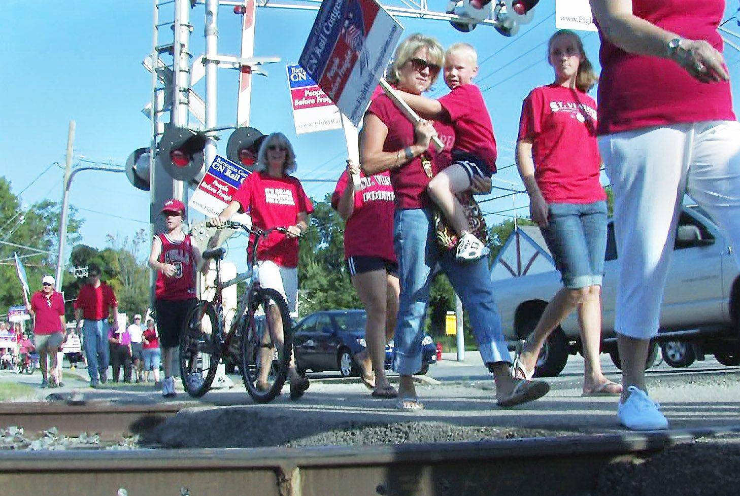 Protesters of Canadian National Railway's purchase of the Elgin, Joliet & Eastern Ry. march to a Surface Transportation Board hearing at Barrington High School in August 2008.
