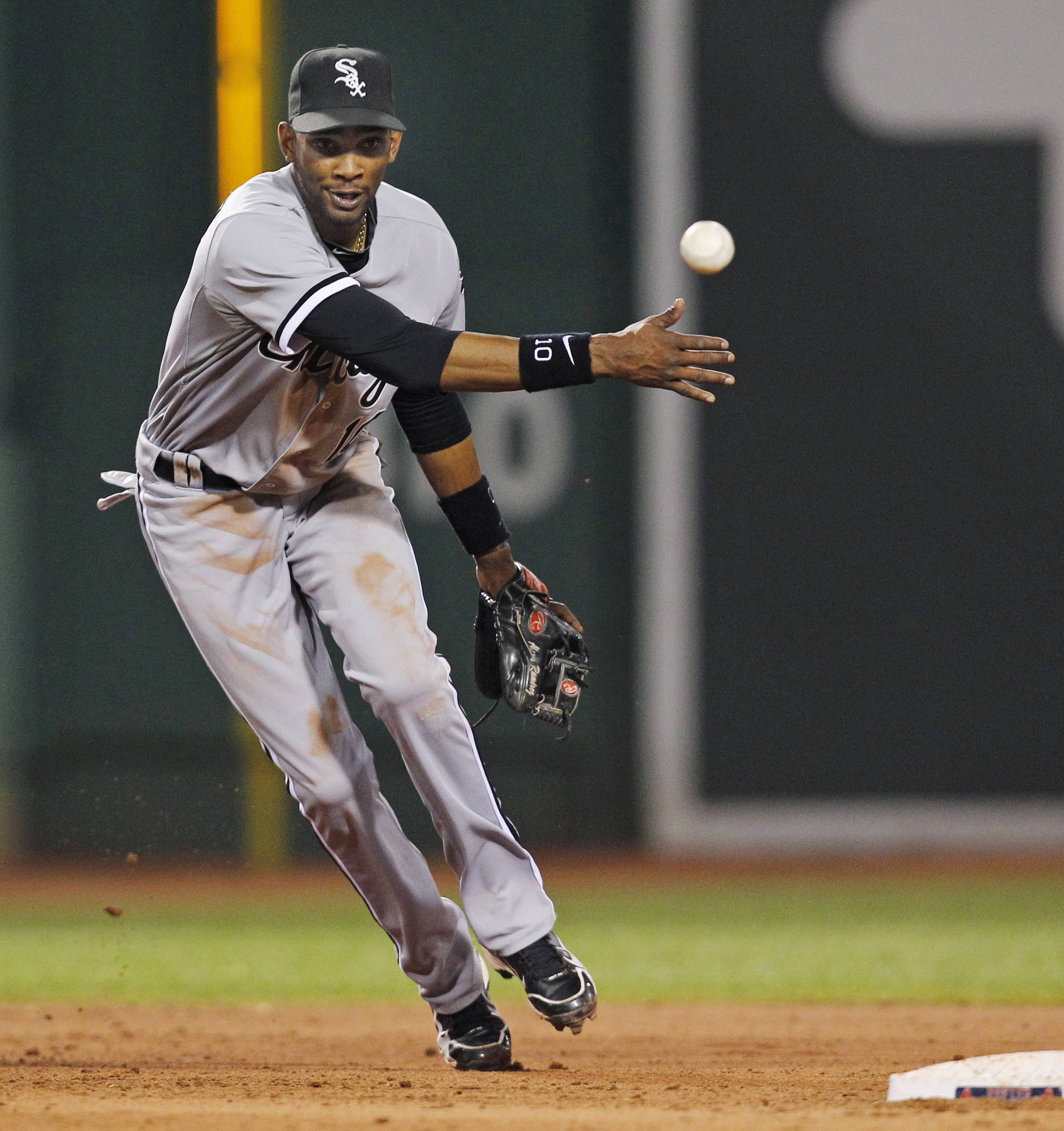Alexei Ramirez tosses the ball to second base during the sixth inning at Fenway Park.