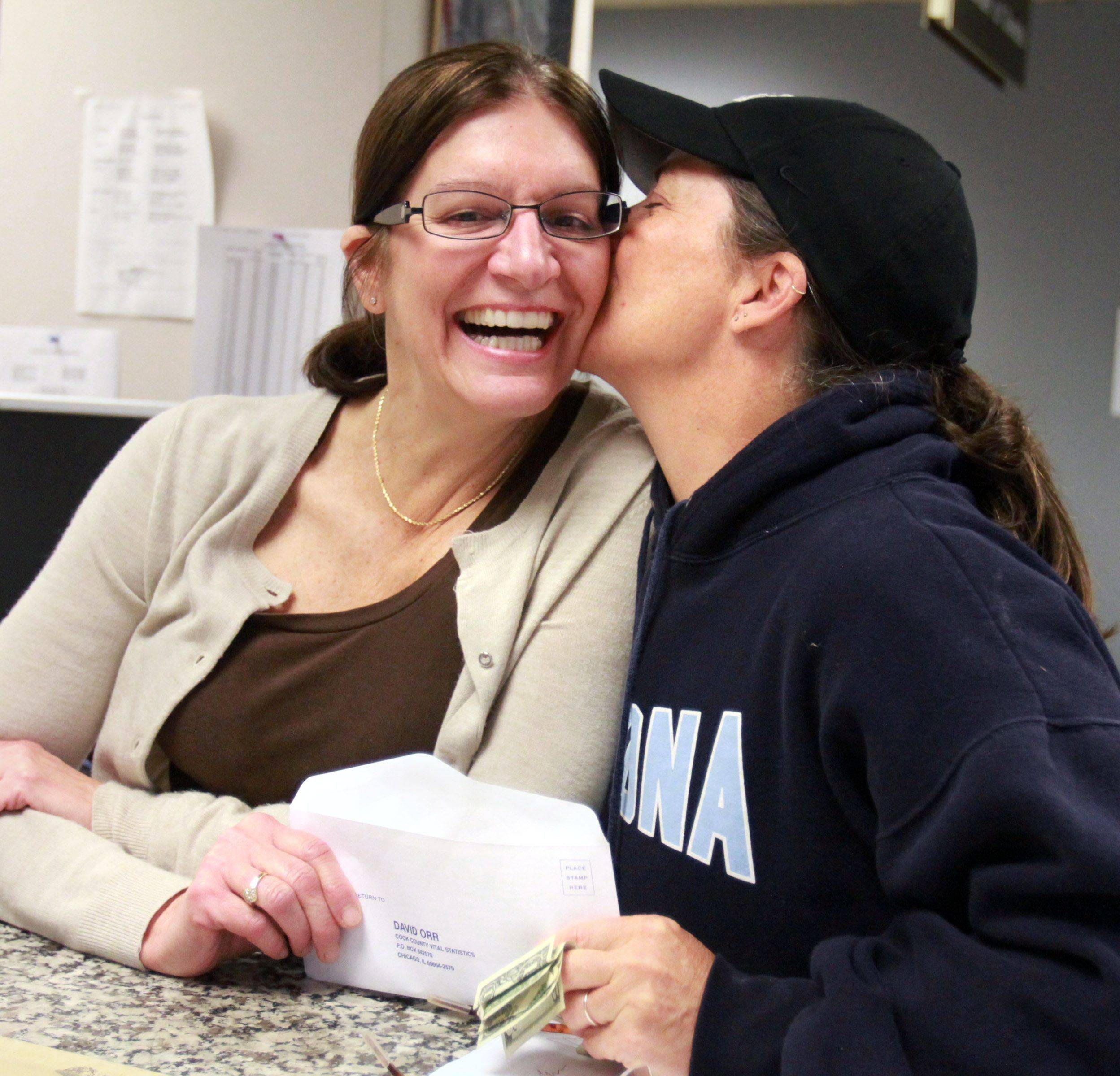 Peggy Ognacevic and Lisa Notarnicola, both of Algonquin, share a moment after receiving their civil union license from Lana Yacilla, supervisor in the Bureau of Vital Statistics office, at the Cook County Court House in Rolling Meadows on Wednesday, June 1st.