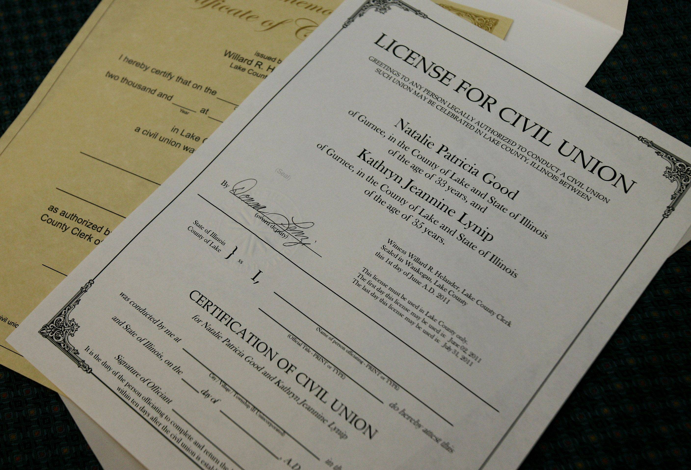 Couples file for civil union licenses Wednesday at the Lake County Clerk's office in Waukegan.