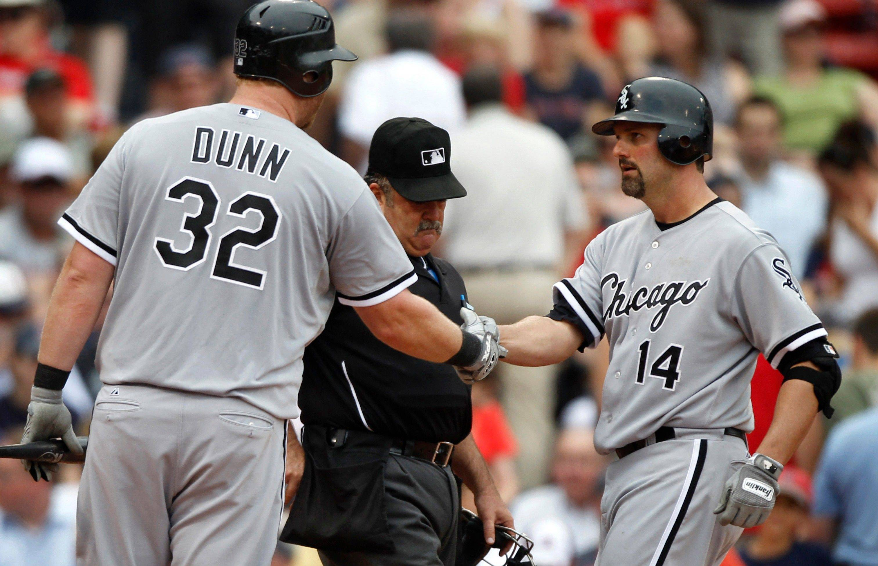 Adam Dunn, left, welcomes Paul Konerko at home plate after Konerko hit a 2-run home run off Red Sox closer Jonathan Papelbon in the ninth inning Wednesday at Fenway Park.