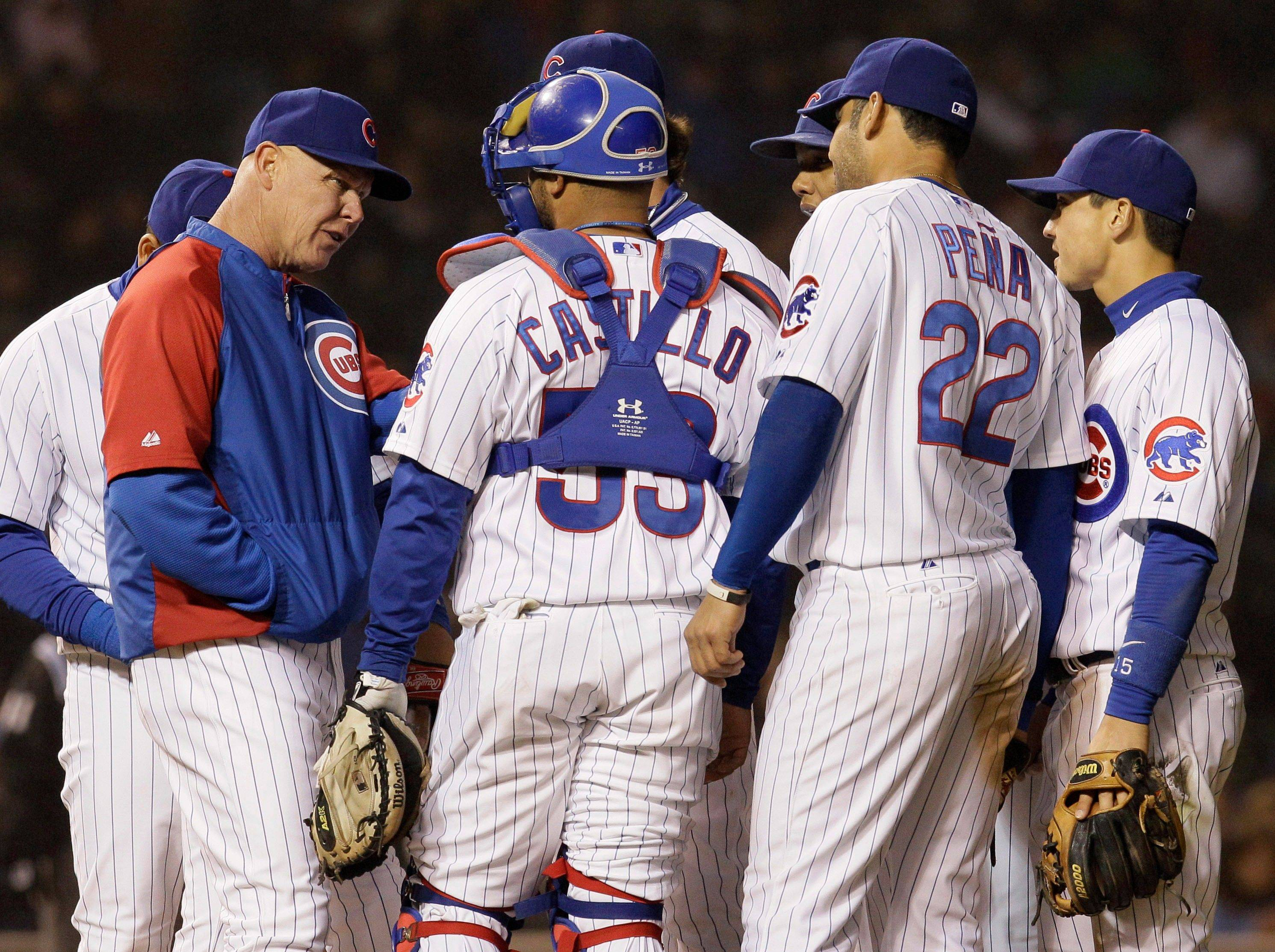 It wouldn't hurt Mike Quade, left, if he started acting more like a major-league manager than a major-league friend to the 25 Cubs on his roster.
