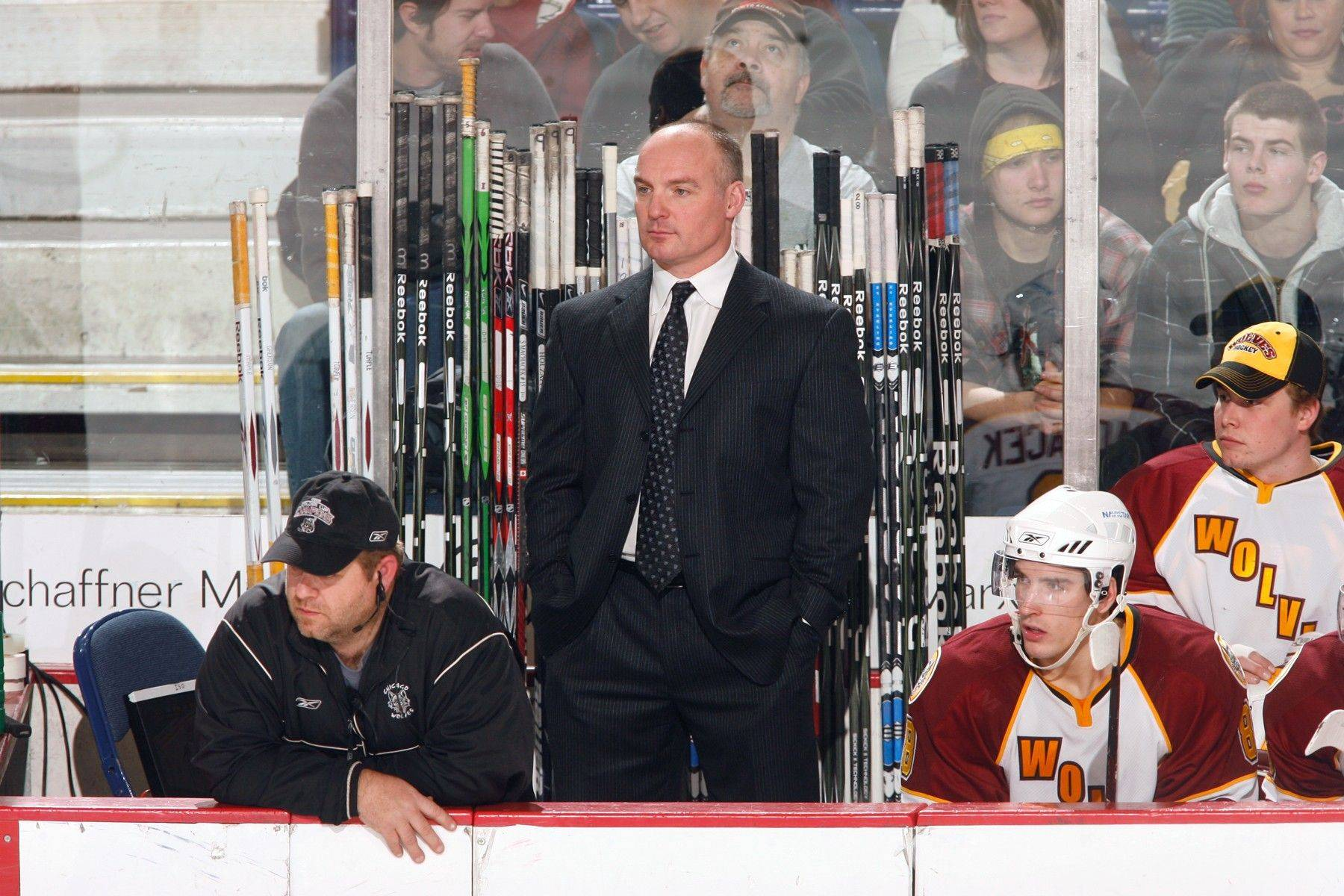 Wolves general manager Wendell Young, center, is in the process of finding another NHL franchise to work with his club. Last season the Wolves were affiliated with the Atlanta Thrashers, who are moving to Winnipeg.