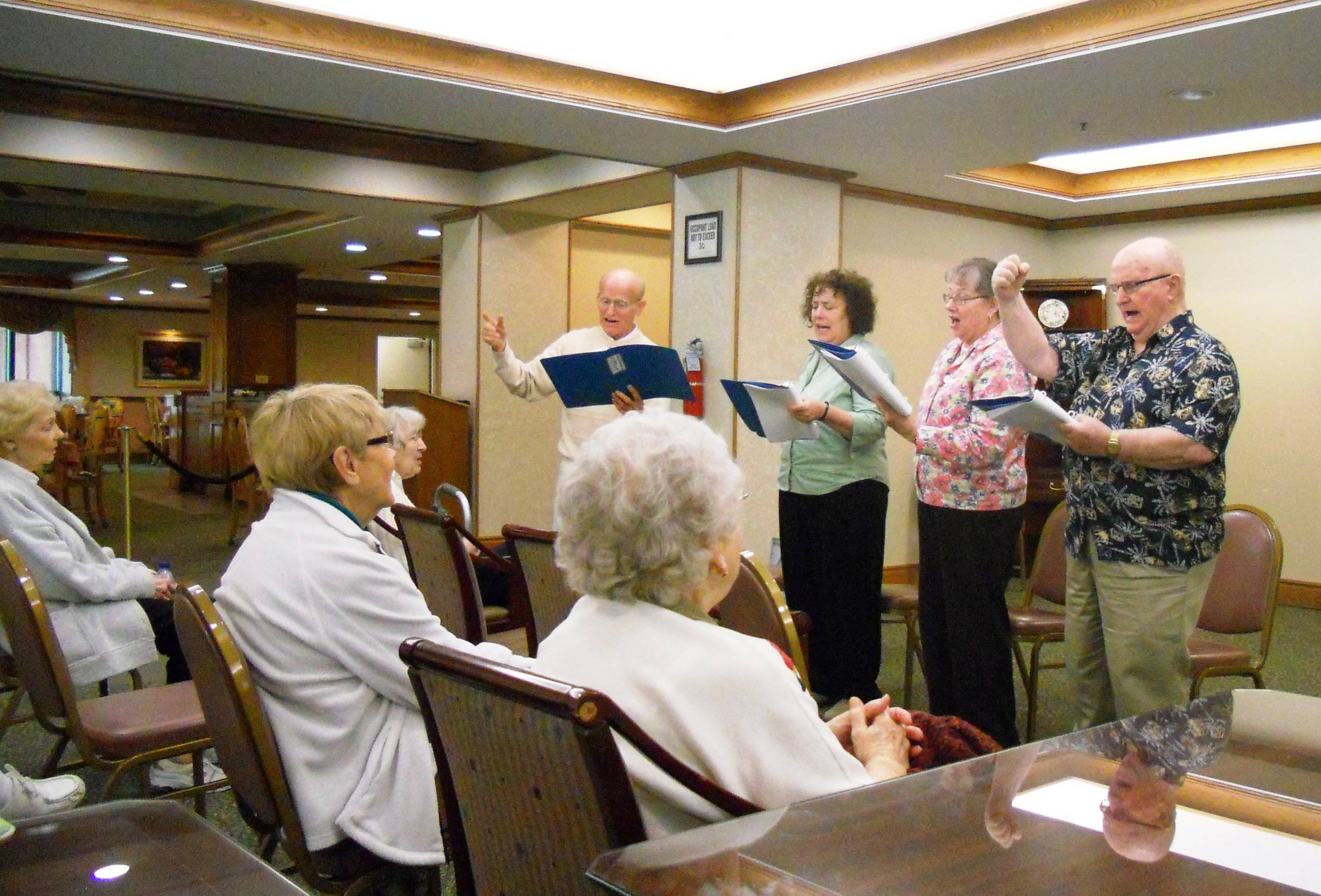 Performers with the Readers' Theatre Group, from left, Joe Schrantz, Carolyn Wiss-Miller, Mary Tomaso and Harry Schaudt, perform for seniors.