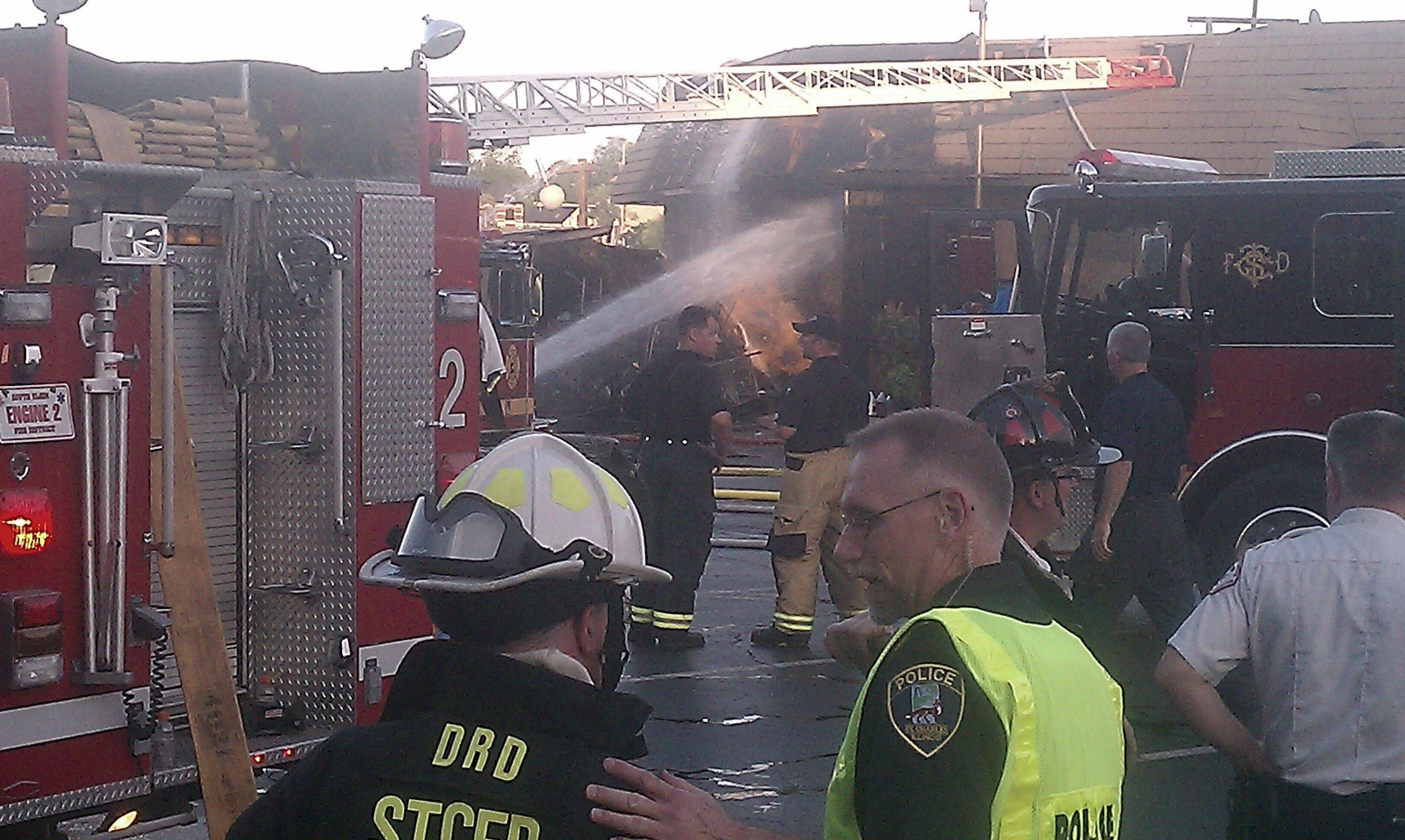 Firefighters battle a blaze at Salerno's on the Fox restaurant Wednesday in St. Charles.