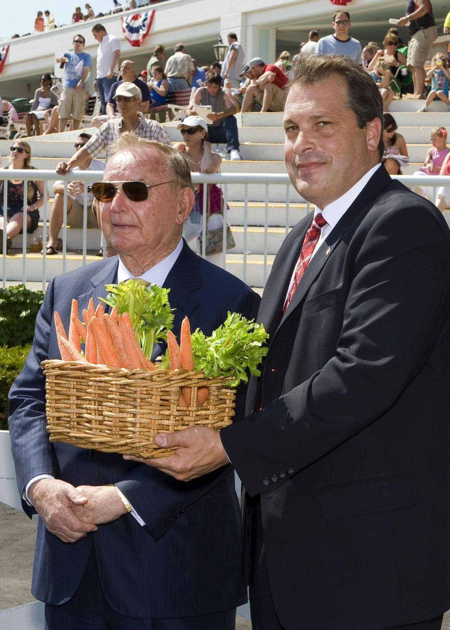Arlington Park chairman Richard L. Duchossois, left, and general manager Tony Petrillo were on hand to share a retirement gift with General Charley, one of the most popular horses at the track.