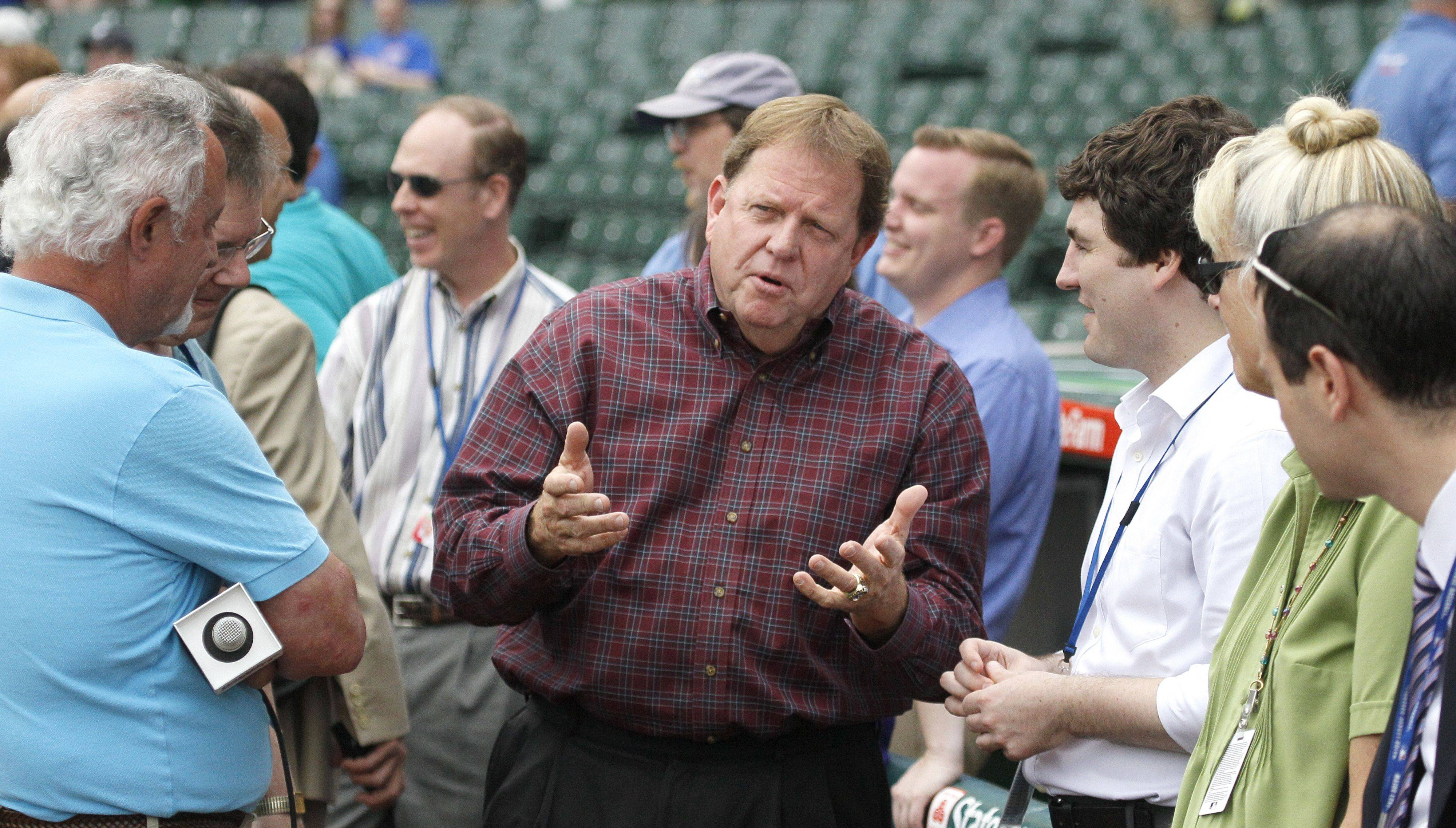Cubs general manager Jim Hendry, center, who has been running the team since the 2003, is the focus of many Cubs fans who want a change in direction with the struggling club.