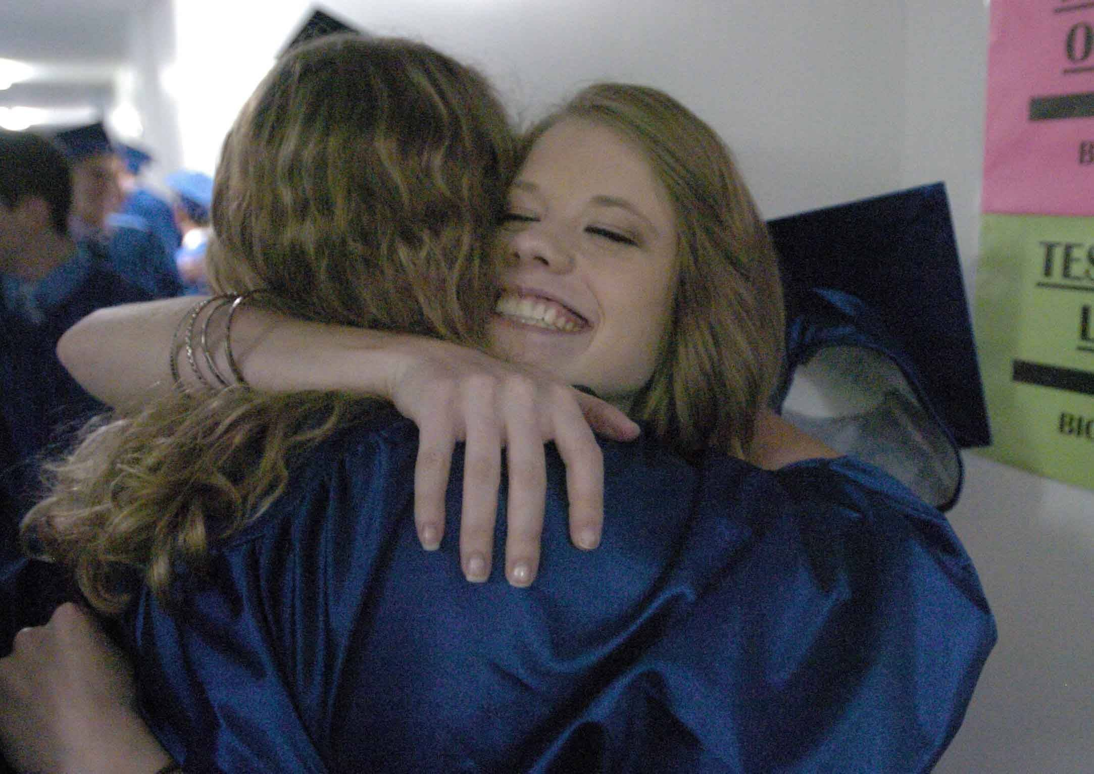 Wenona Gierzynski, left, hugs Stephanie Dreyer during the Wheaton North High School Graduation Saturday.