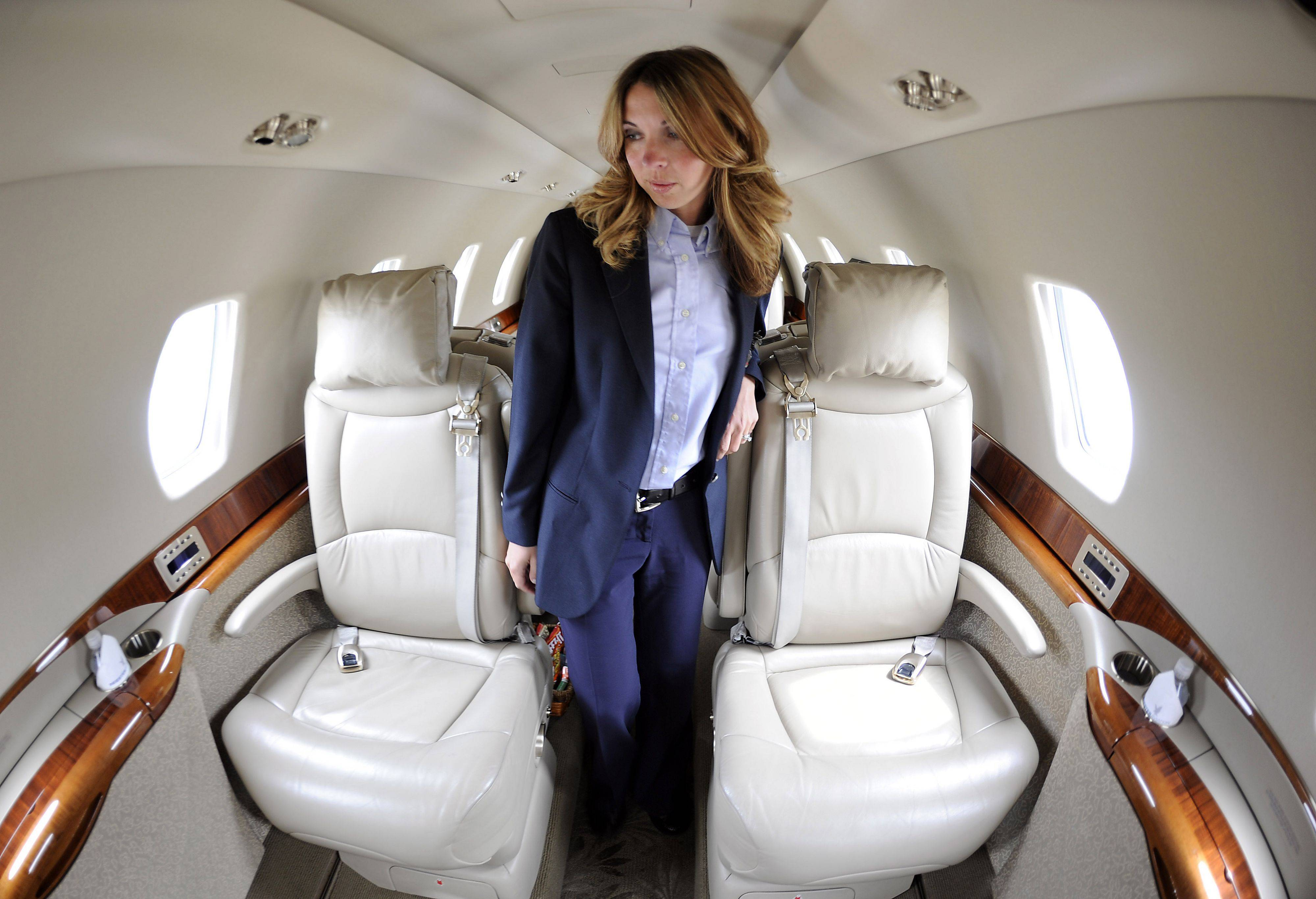 Pilot Amanda Sorenson of Priester Aviation gets ready for takeoff by checking all the controls in her Citation Sovereign aircraft with her fellow pilot Fred Bartlett of Burlington, WI., before she leaves Chicago Executive Airport.
