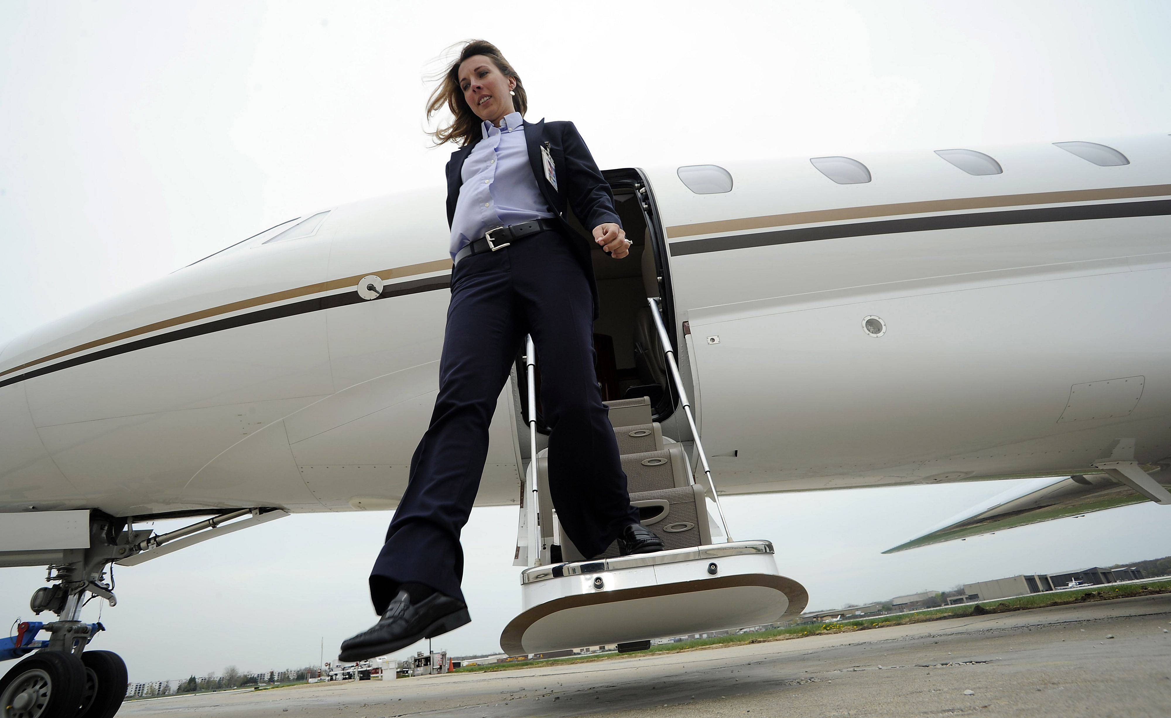 Sorenson leaves her Citation Sovereign aircraft heading back to the hanger to check the weather and gives the thumbs-up before she leaves Chicago Executive Airport.
