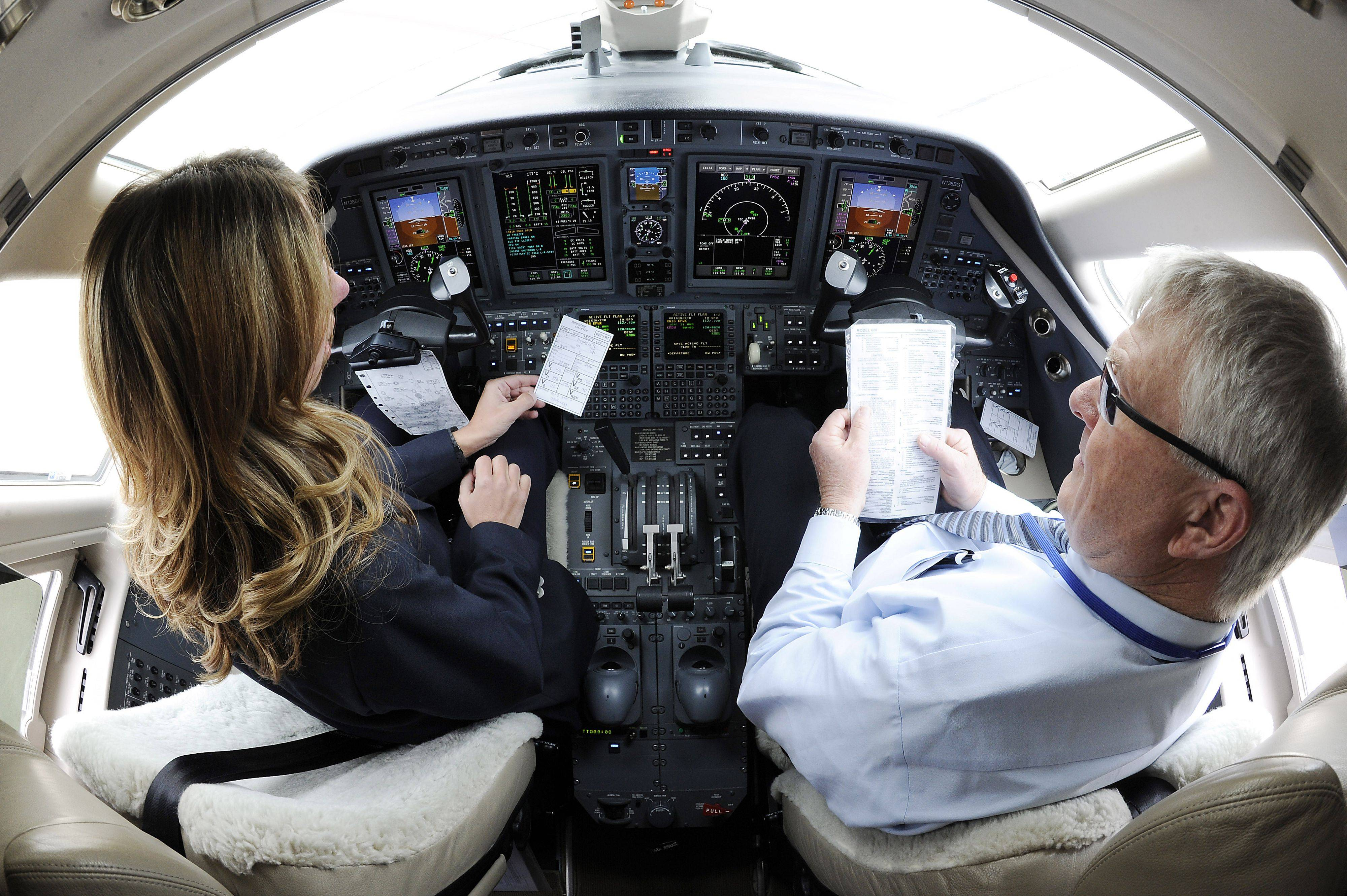 Wheeling's Pilot Amanda Sorenson of Priester Aviation gets ready for takeoff by checking all the controls in her Citation Sovereign aircraft with her fellow pilot Fred Bartlett of Burlington, Wisconsin before she leaves Chicago Executive Airport.