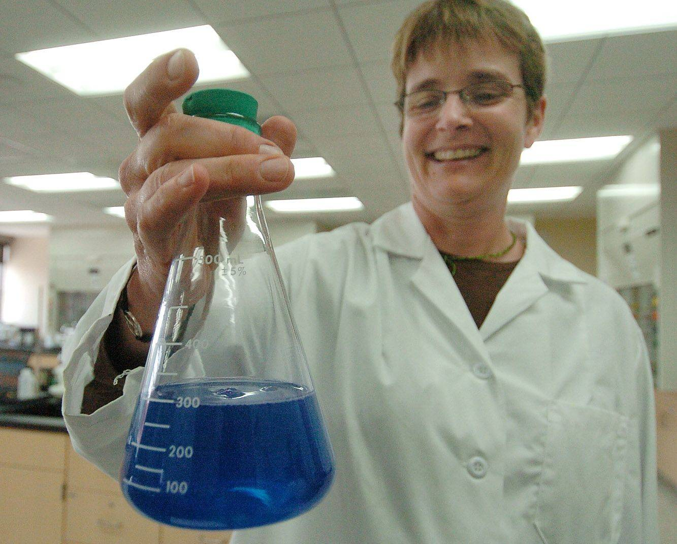 Nancy Christiensen demonstrates oxidation of sugar during a demonstration in her chemistry laboratory during an open house Friday at Waubonsee Community College's new downtown Aurora campus.