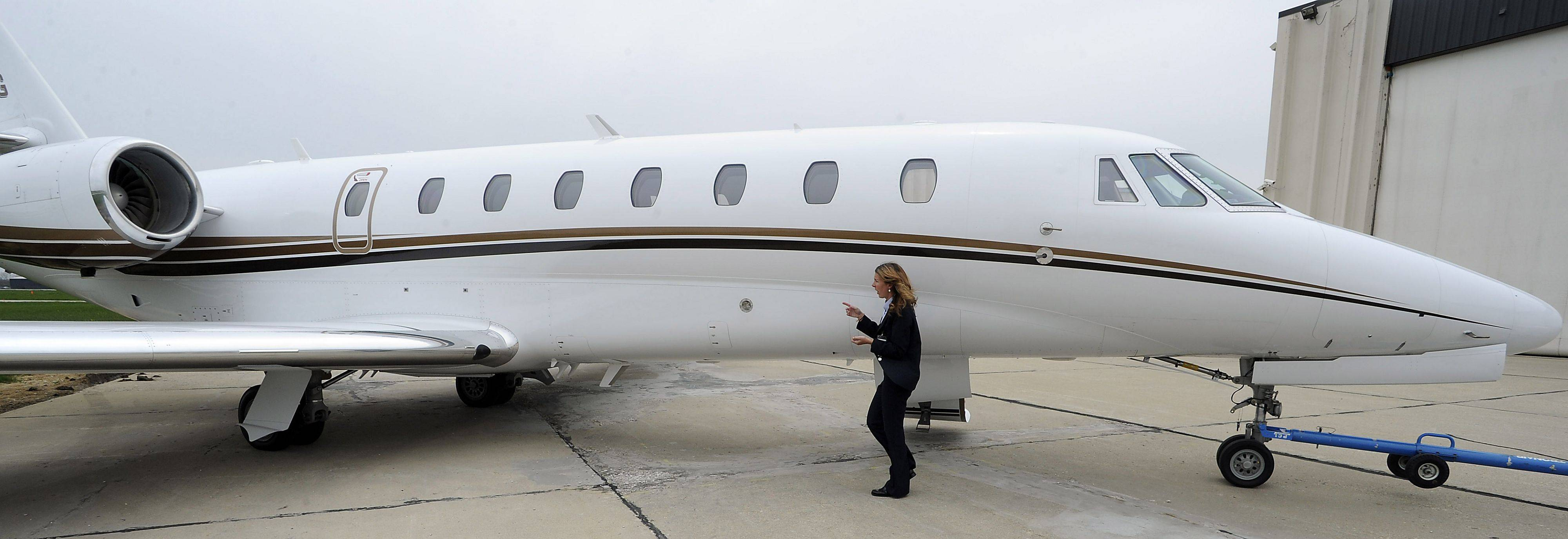 Amanda Sorenson of Priester Aviation does a walk around on her Citation Sovereign aircraft before she takes off from Chicago Executive Airport.