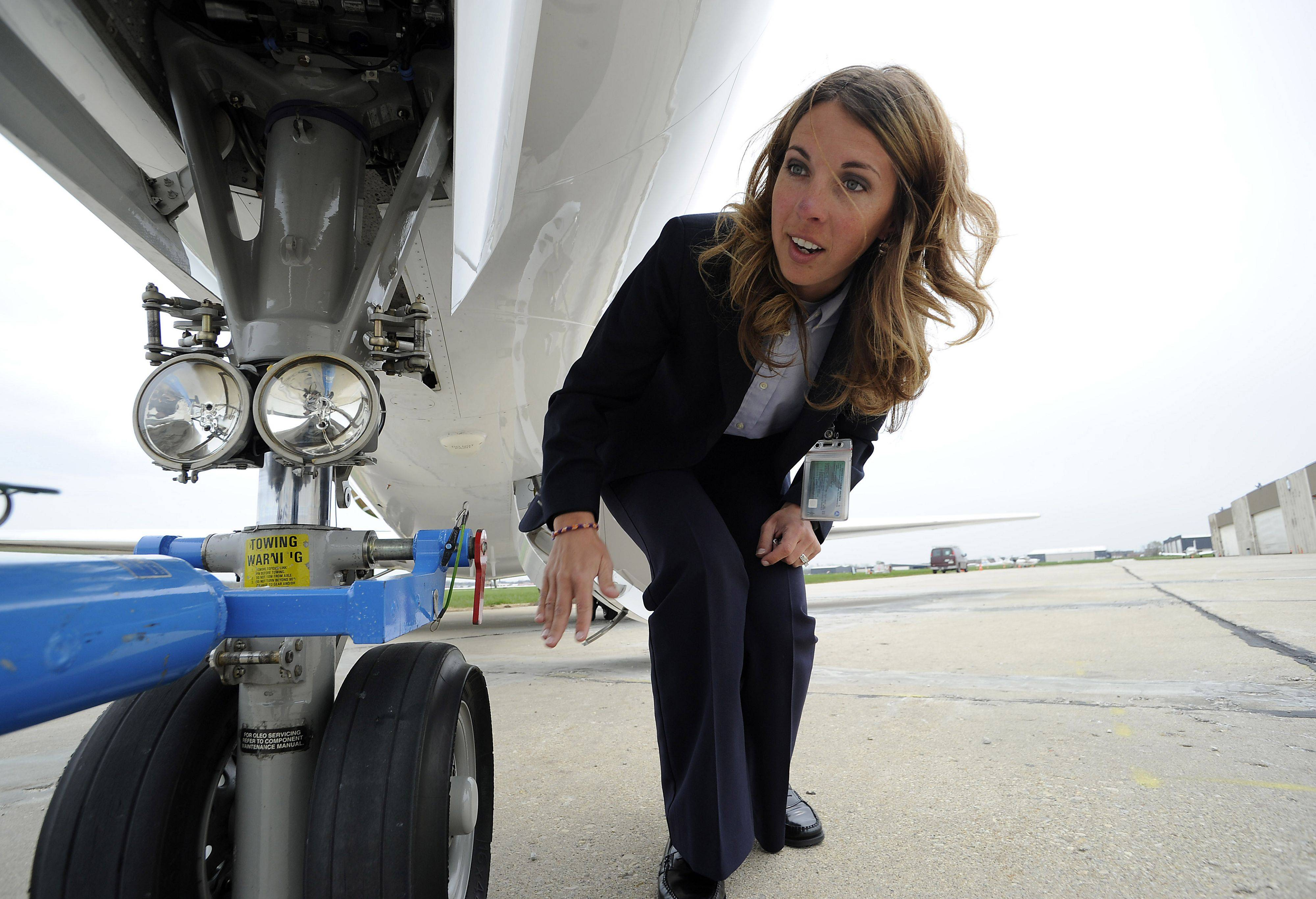 Amanda Sorenson of Priester Aviation checks the landing gear tires, making sure there are no cuts to ensure her Citation Sovereign aircraft is air worthy before she departs from Chicago Executive Airport.