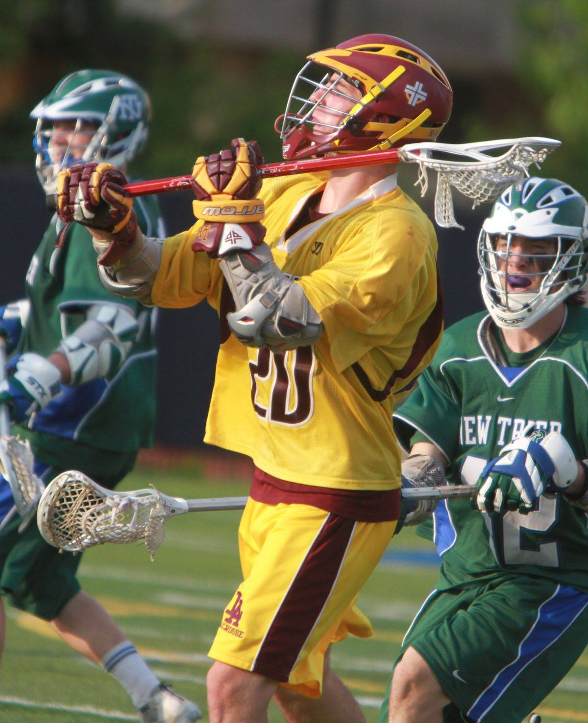 Loyola Academy's Tom Sullivan looks to pass against New Trier in the IHSLA state lacrosse championship game in Oak Park on Saturday.