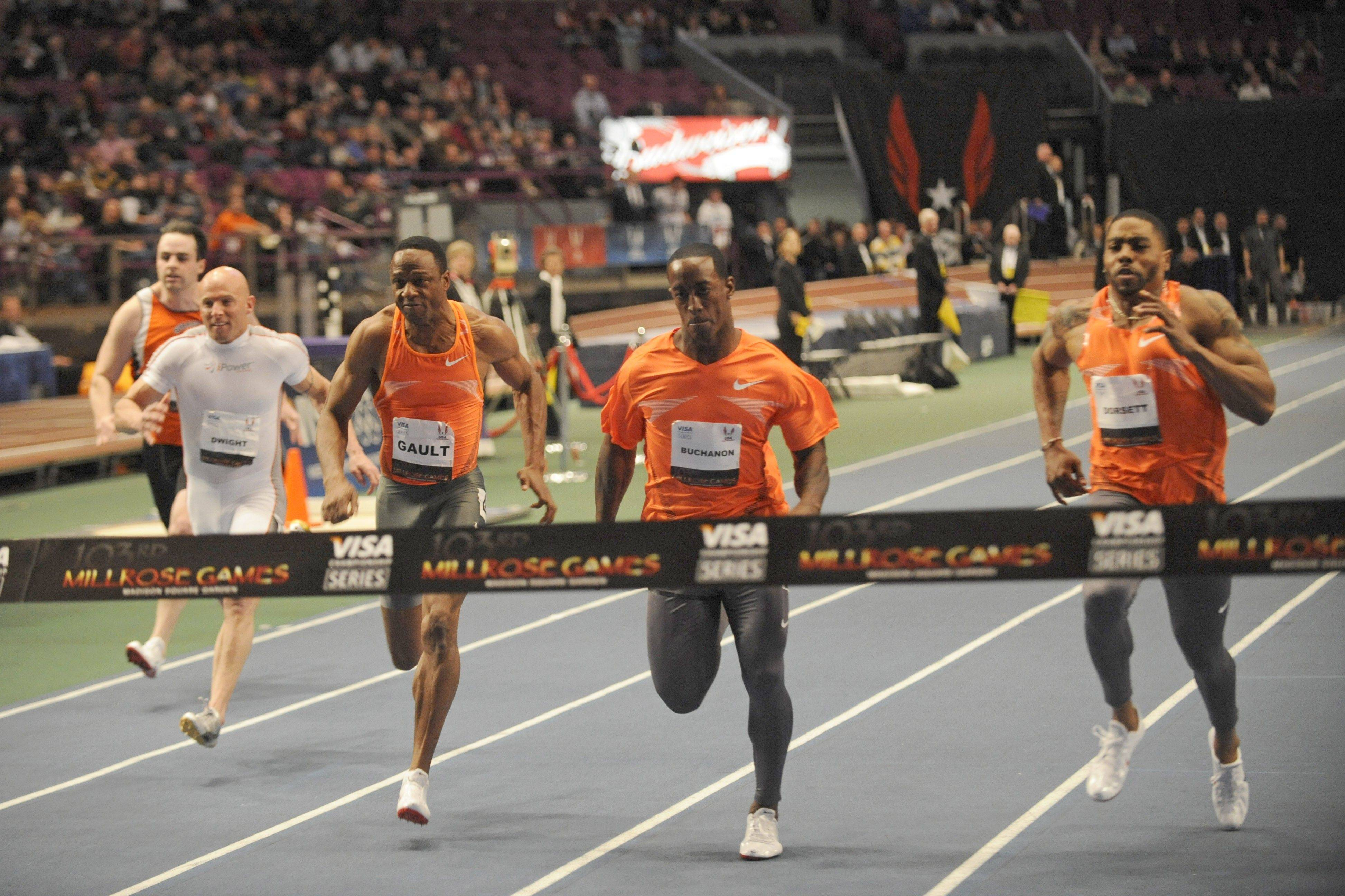 Last year, former Bears receiver and world class sprinter Willie Gault, third from left, raced several former NFL players in the 60-meter dash at the Milrose Games. Anthony Dorsett Jr., 13 years younger than Gault, won the contest. Gault, however, recently set two world records at a masters track event.