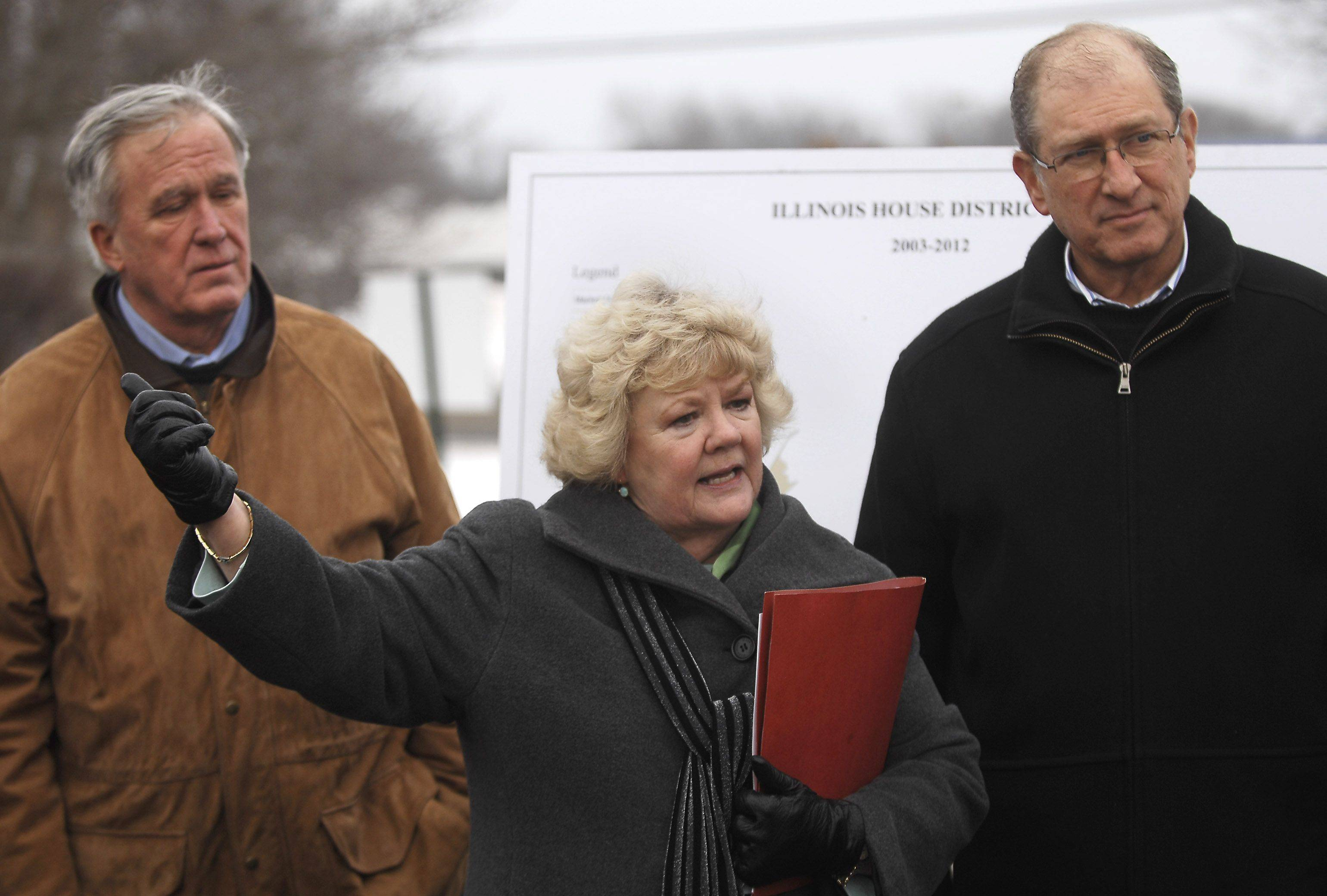State Rep. Mark Beaubien, left, stands with former state Rep. Suzie Bassi and state Rep. Sidney Mathias in January 2010 to talk with residents about businesses leaving Cook County because of high sales taxes. Beaubien collapsed and died Sunday while attending a fundraiser at Arlington Park.