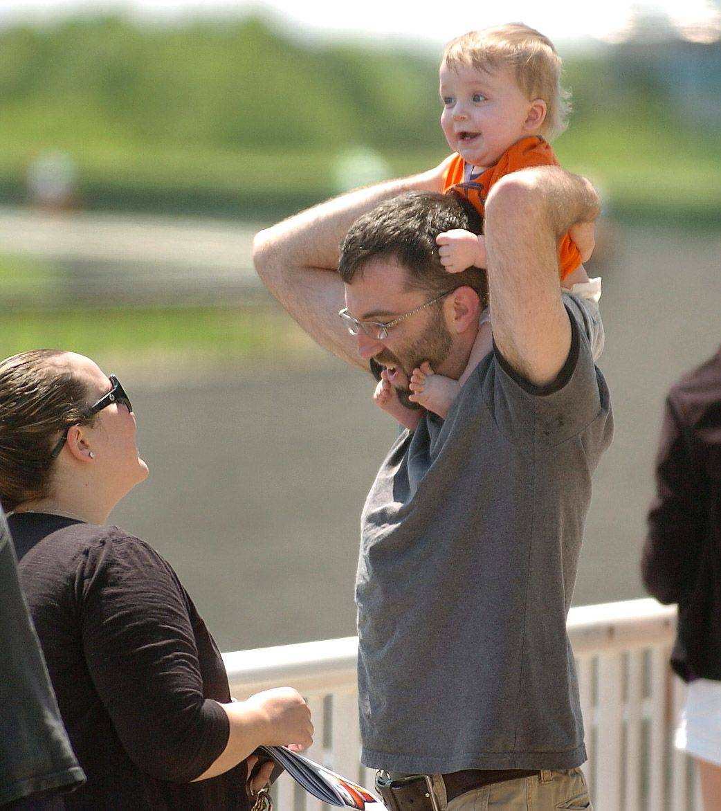 While Tony Ardizzone and Jessica Armour of Lake Forest say they would play slot machines if they were available at Arlington Park, their 9-month-old son Elias just wants to get a better look at the horses.