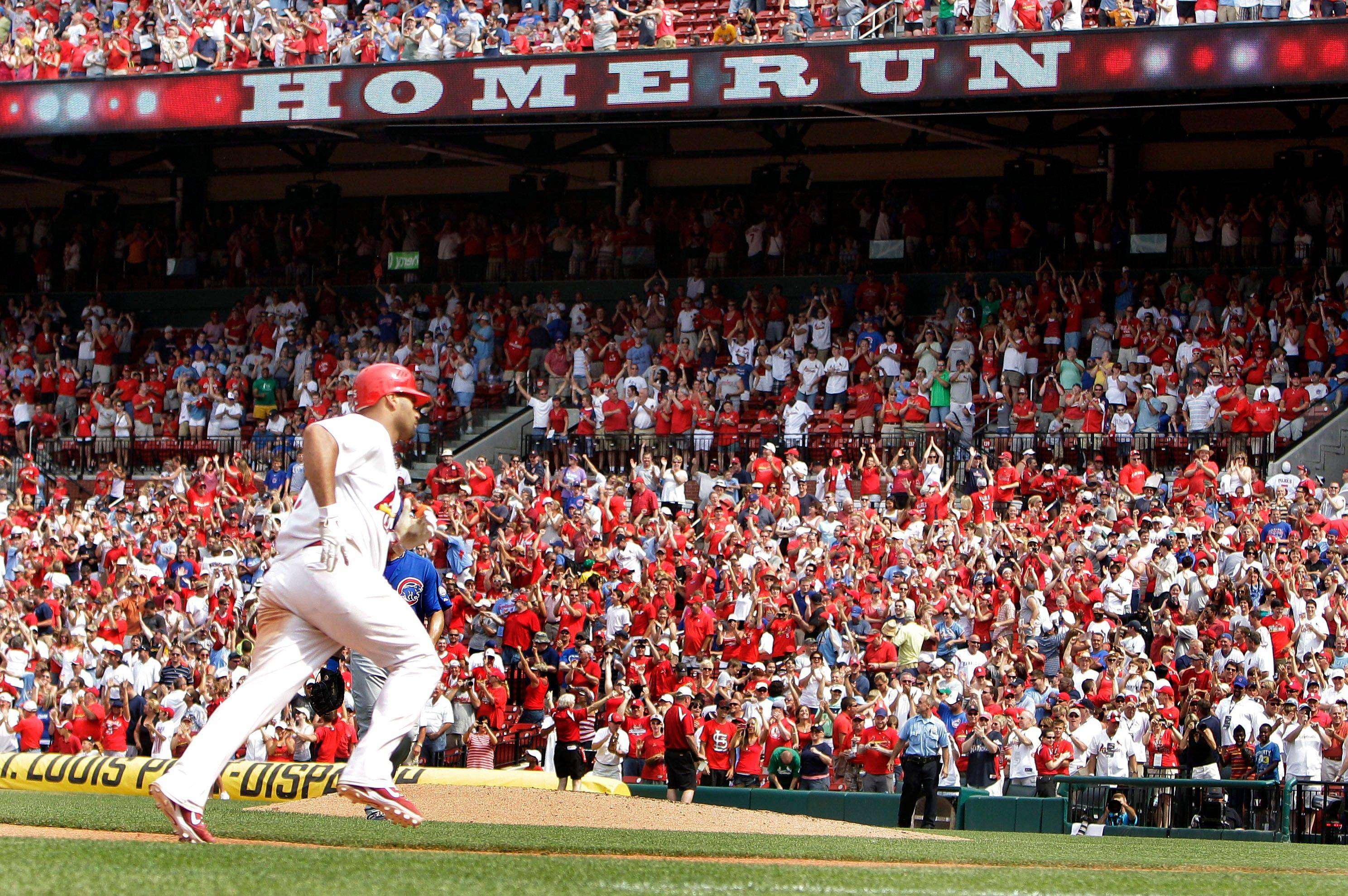 St. Louis Cardinals' slugger Albert Pujols rounds third and heads for home after hitting a walkoff home run to defeat the Cubs 3-2 in Sunday's 10th inning.