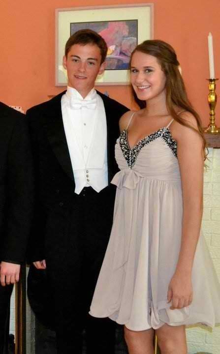 Nicholas Casati, wearing the suit, with his date, Carolynn Pelletier, before the Loyola Academy prom.