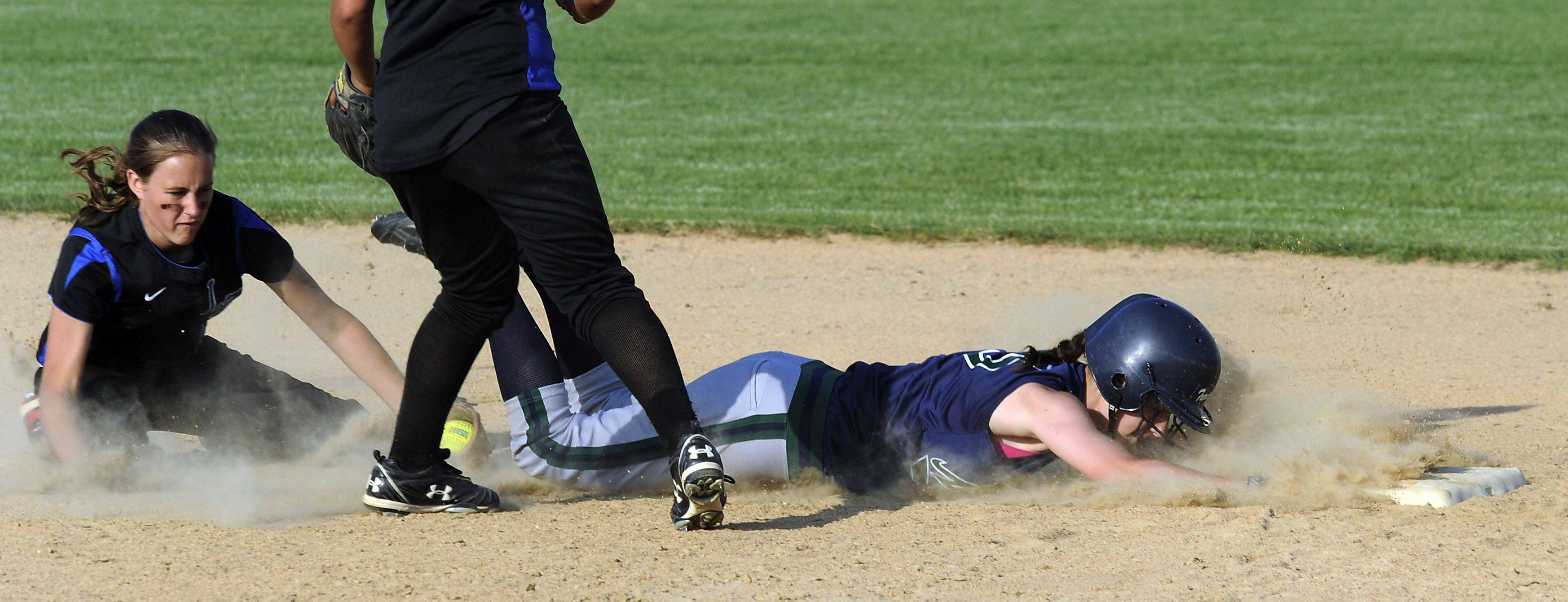 Lake Zurich's shortstop Tabbetha Bohac puts the tag on New Trier's Jessica Tetzlaff after she over-ran second base in the sixth inning in this strong defensive play in the Class 4A Glenbrook South softball supersectional title game on Monday.