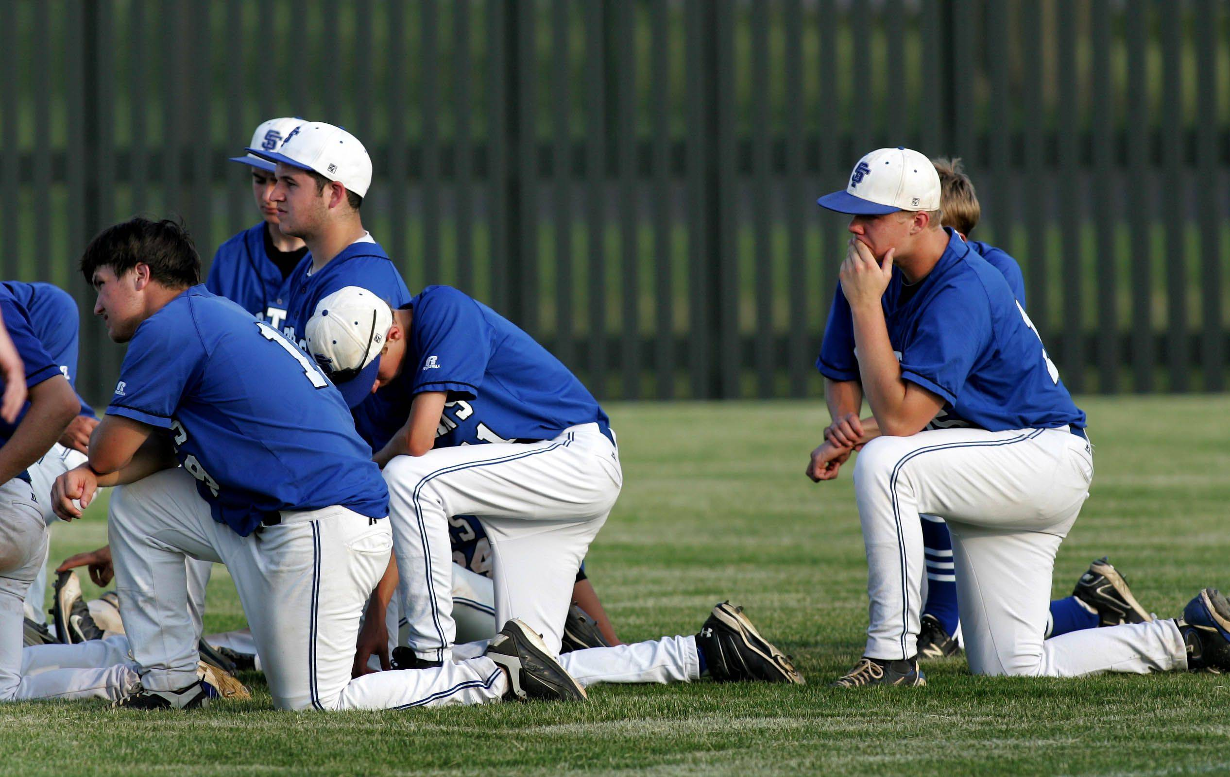 St. Francis react after their loss to Nazareth Academy in Class 3A supersectional baseball Monday in Naperville.