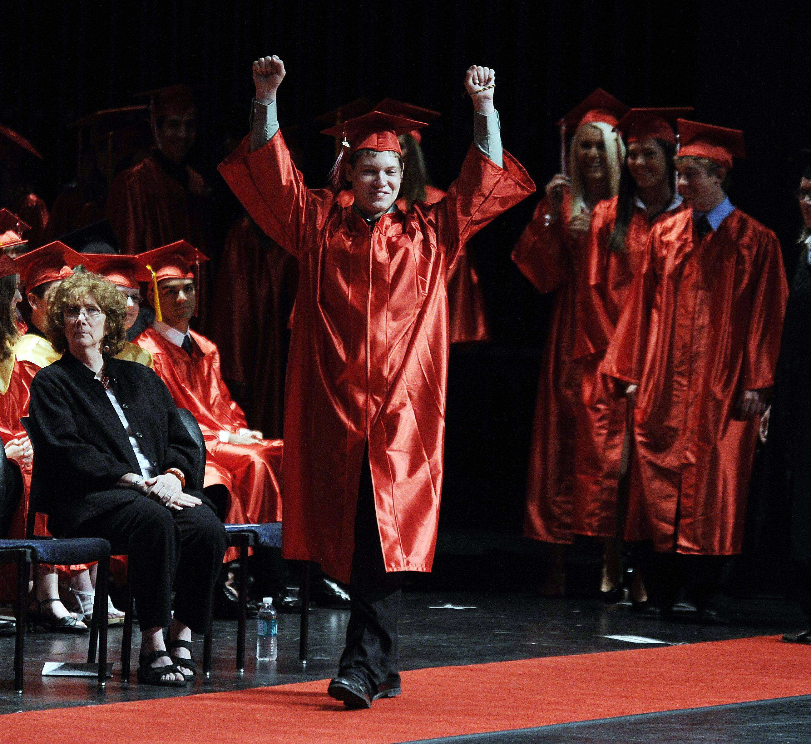 Maine South soon-to-be graduate Jacob Wiener gets a big round of applause as he marches to accept his diploma .