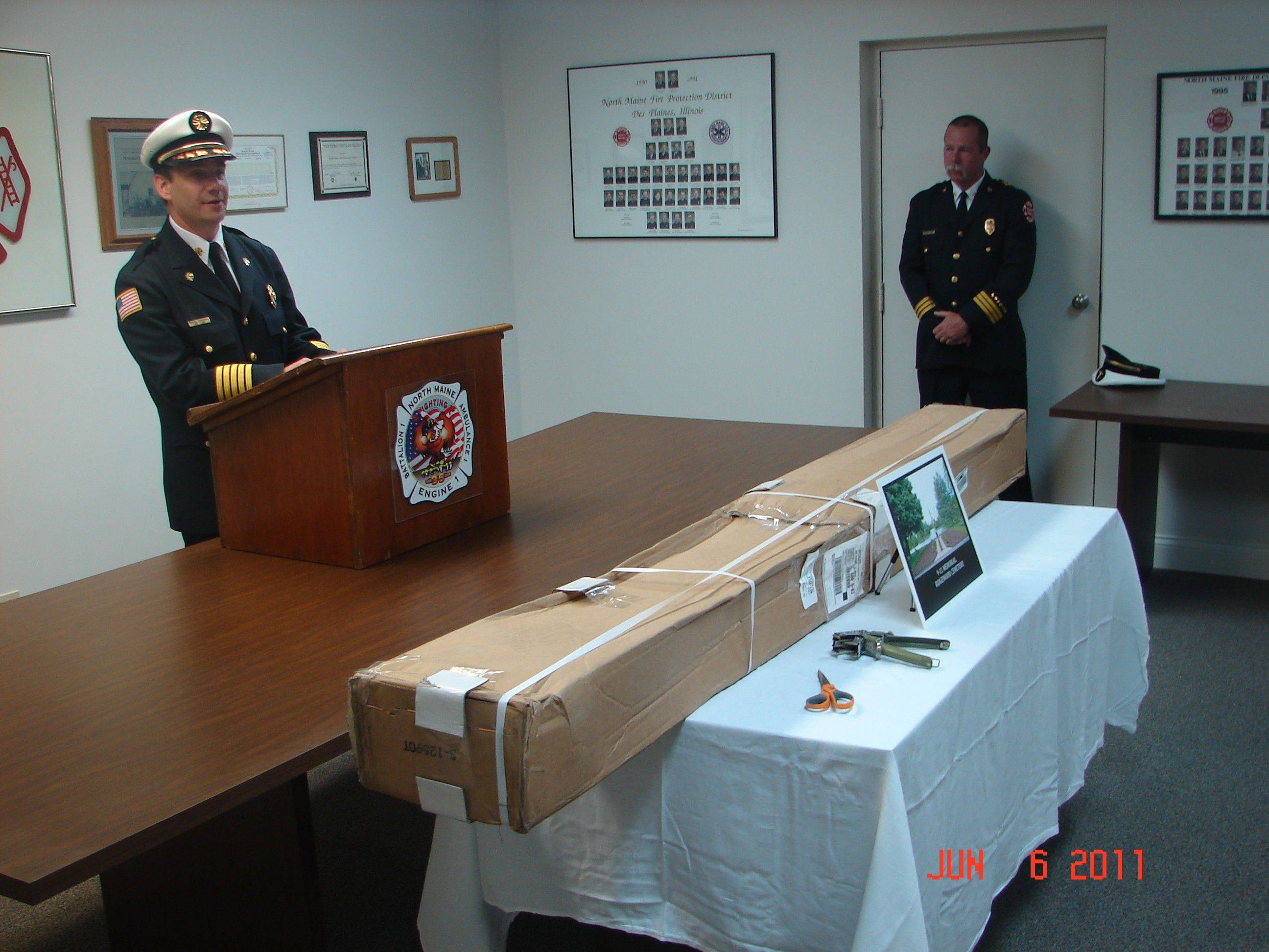 North Maine Fire Chief Rick Dobrowski, left, addresses a crowd gathered for this week's unveiling of a steel artifact salvaged from the World Trade Center towers in New York City after the Sept. 11, 2001 terror attacks.