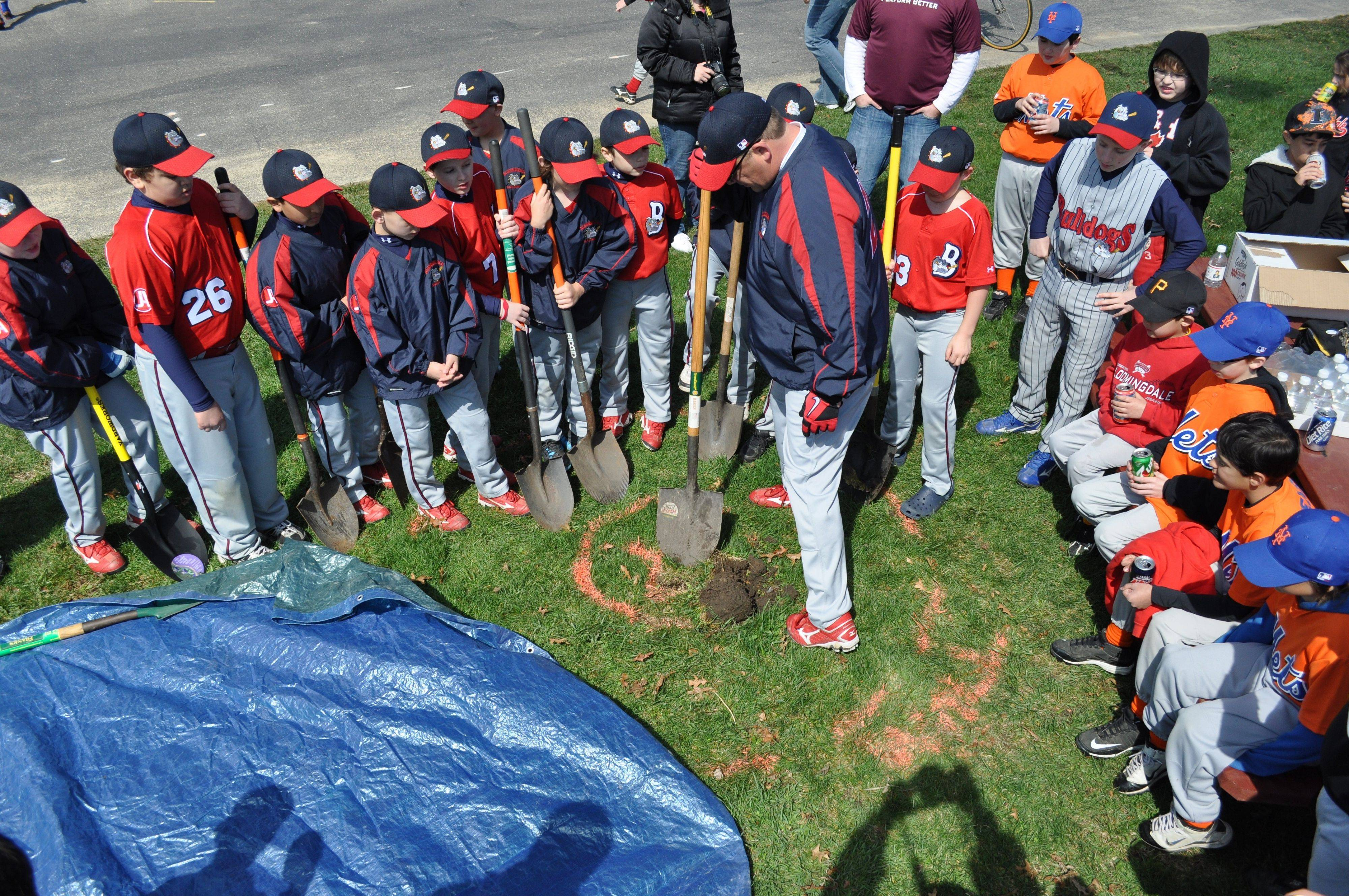 Bloomingdale Bulldogs manager Frank Saverino Jr. and his team prepare to dig a hole for a flagpole memorial honoring Sgt. Jean Claude Nolan.